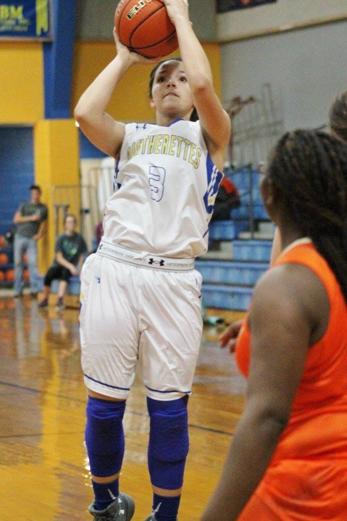 (Photo by Amber Clark) McKayla Figueroa going up for a shot against Honey Grove