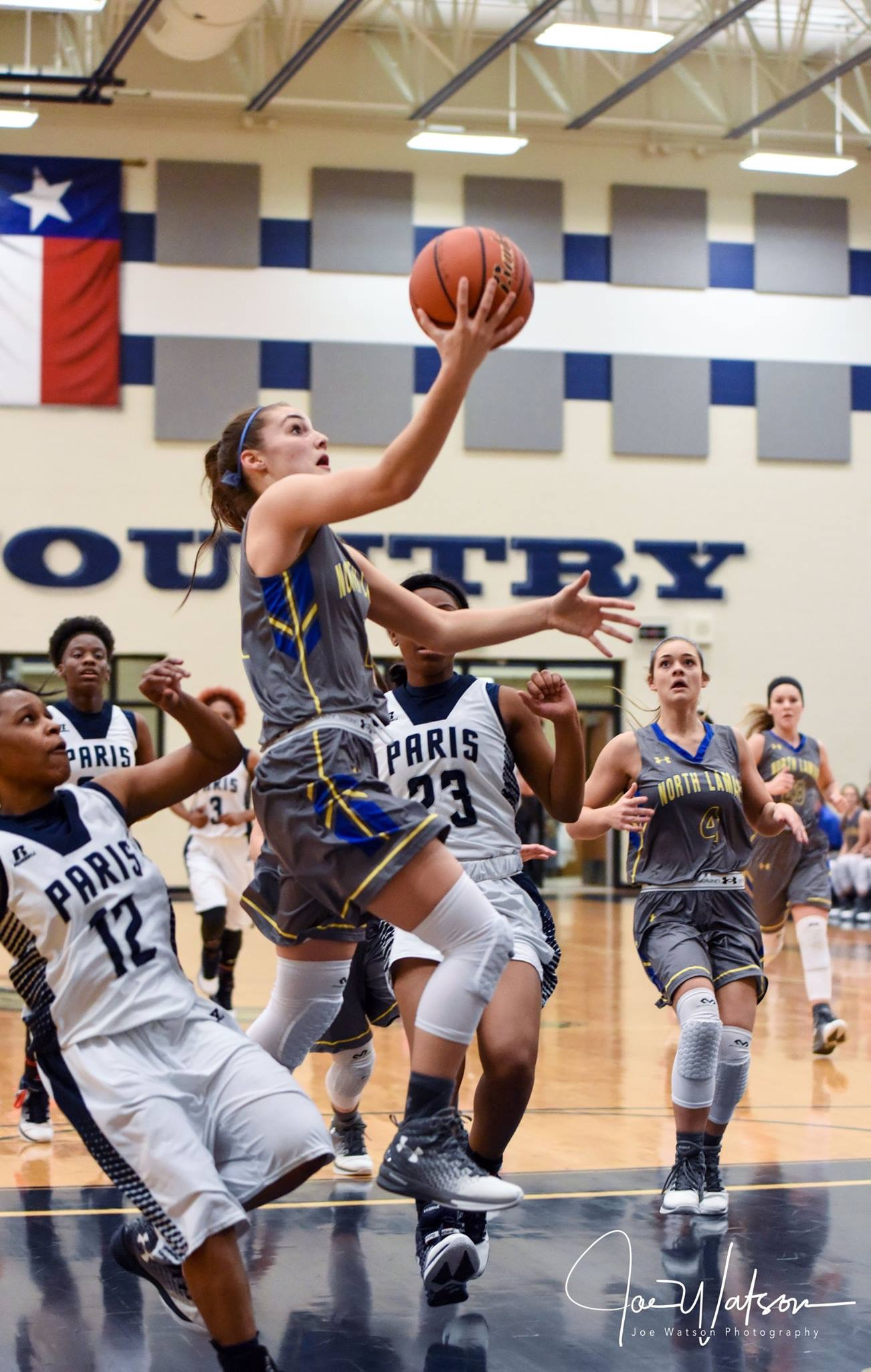 (Photo by Joe Watson) Madison Morrison going in for a layup against Paris High.