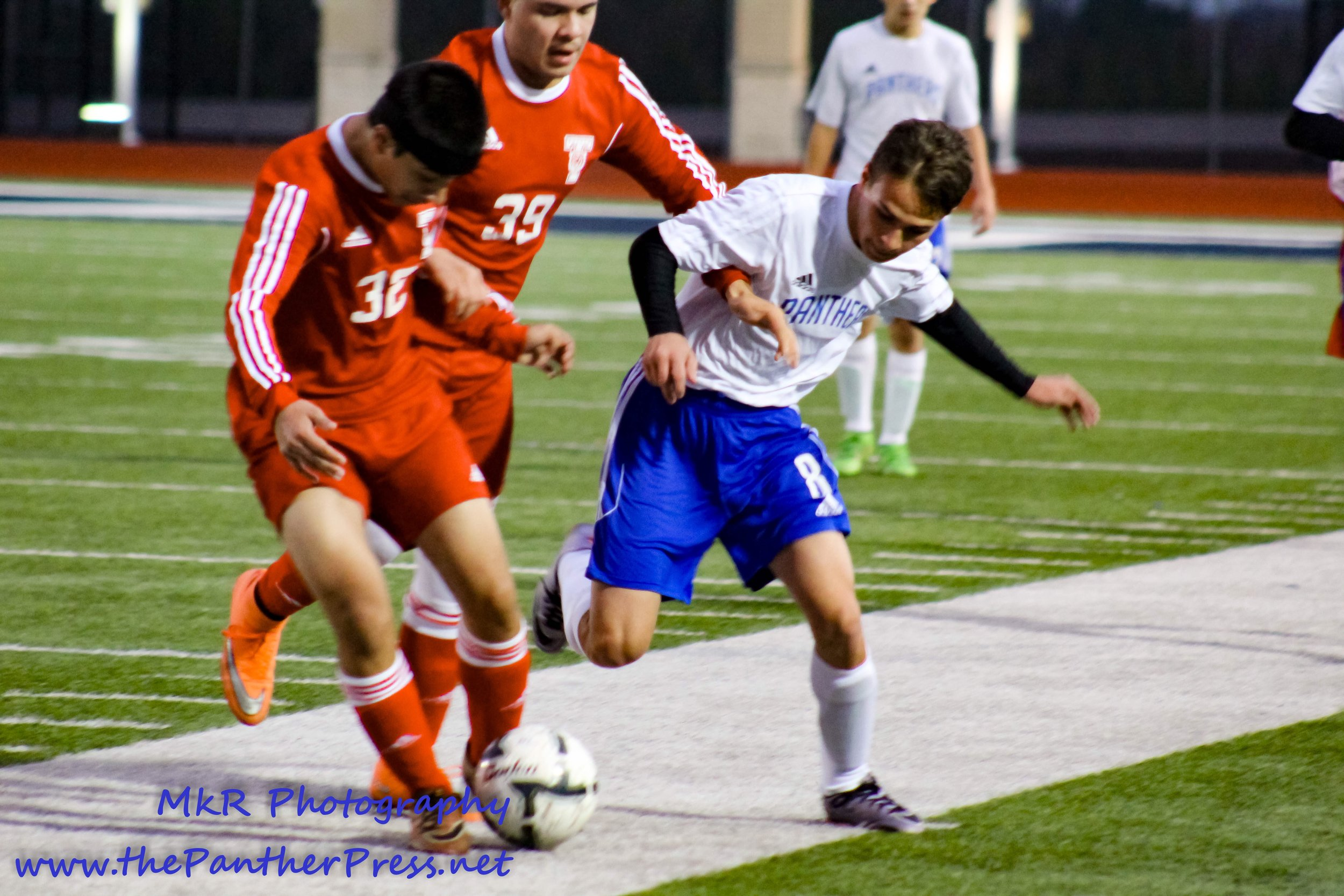 Aaron Meredith fights for possession