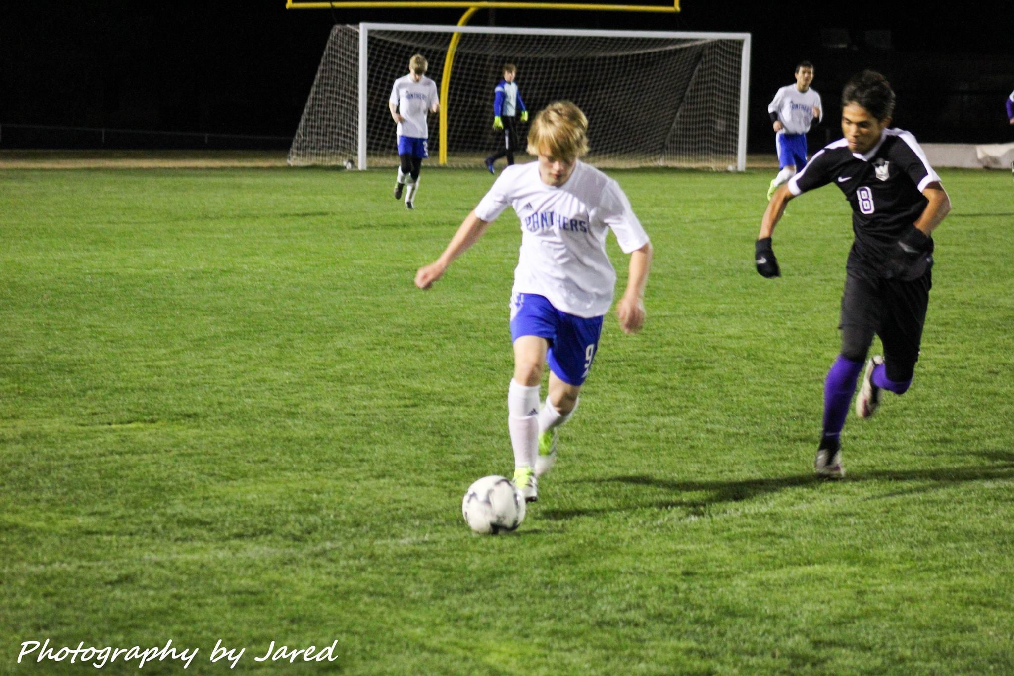 Matthew Meredith with the ball