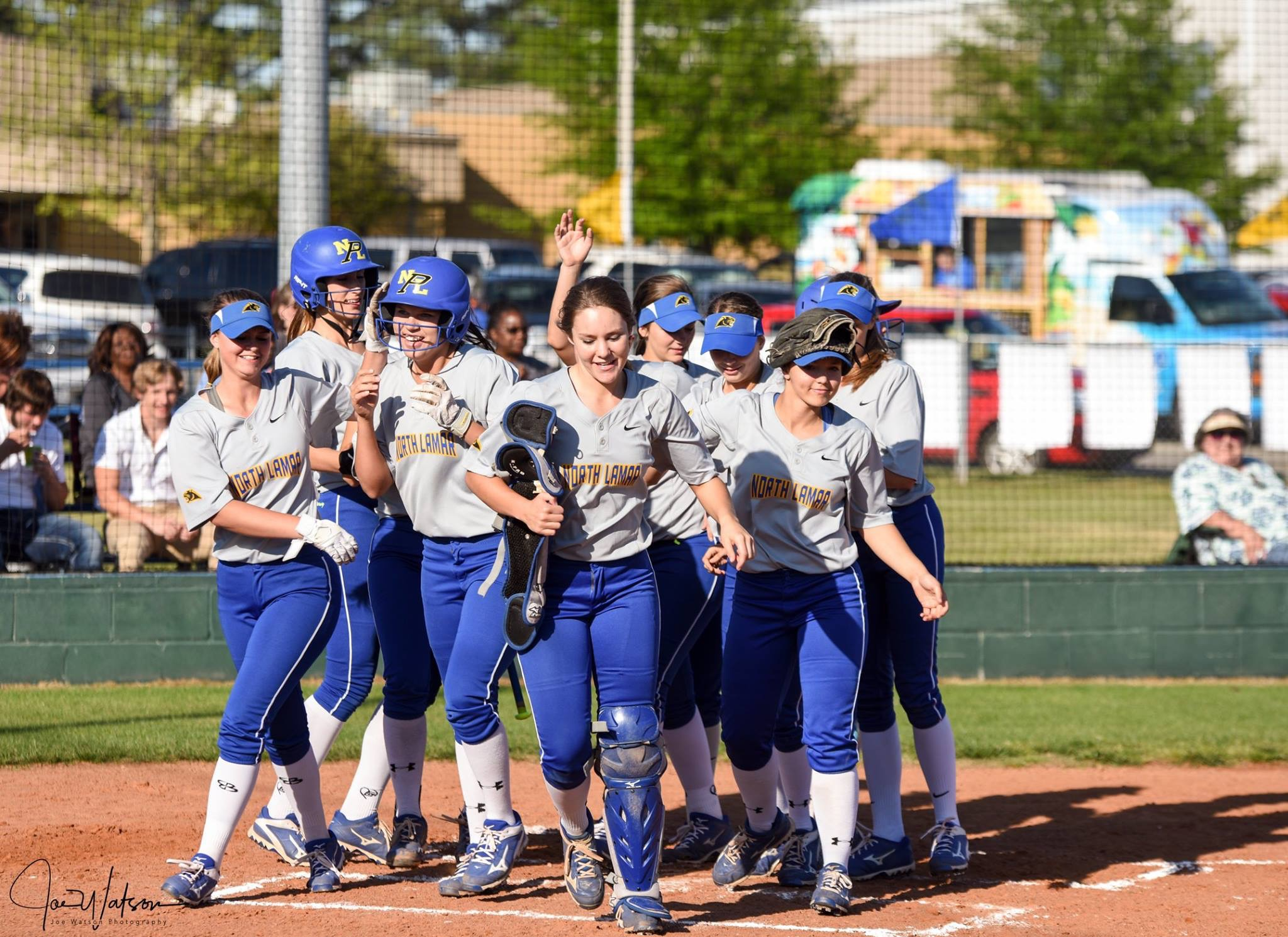 (Photo by Joe Watson) The Pantherettes congratulating Erin Scholl after her solo home run in the third inning Friday night.