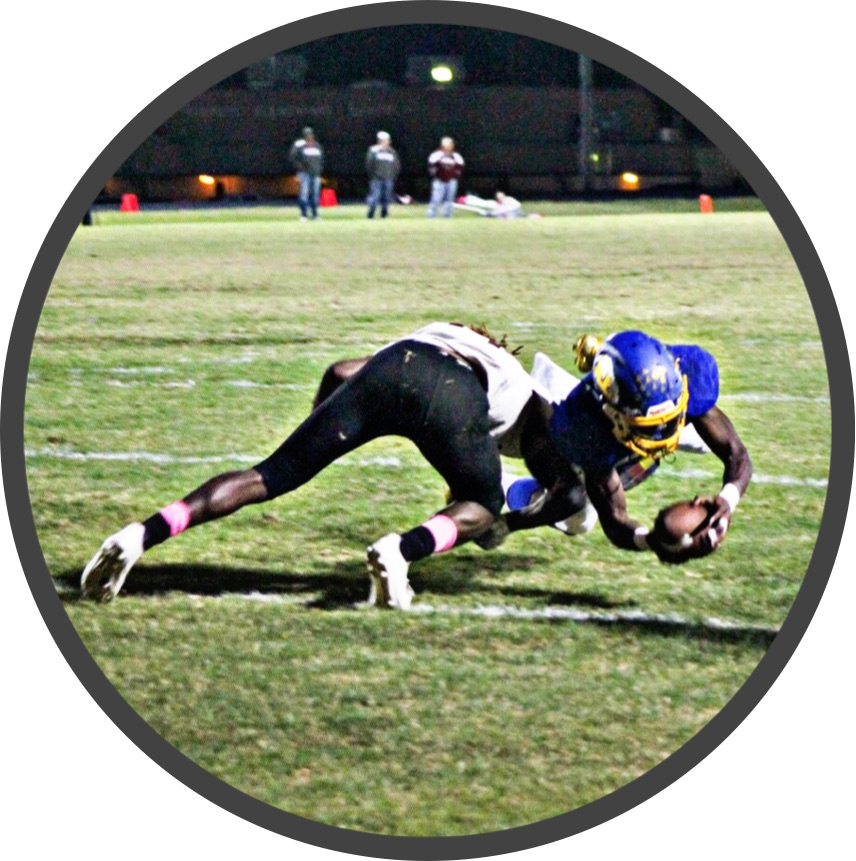 (Photo by Lynn English) Jay Walters dives for his 2nd TD of the night