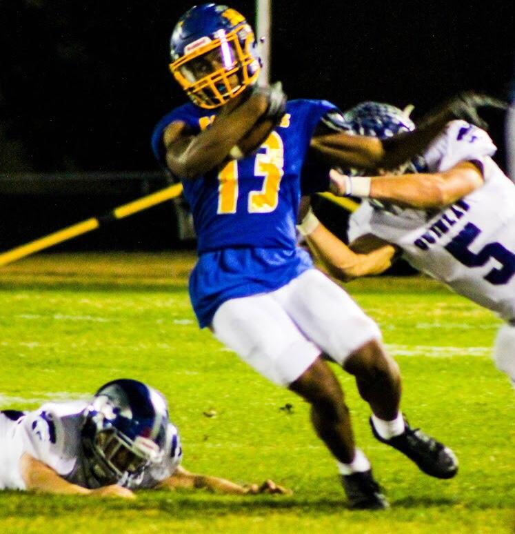 (photo by Lynn English) Seybian Holt fighting through a tackle