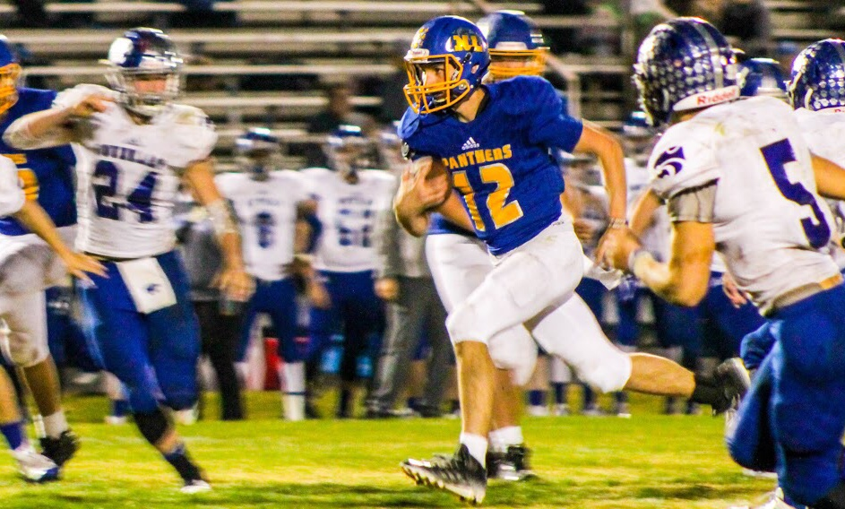 (photo by Lynn English) Austin Allison slices through the defense on the way to the end zone