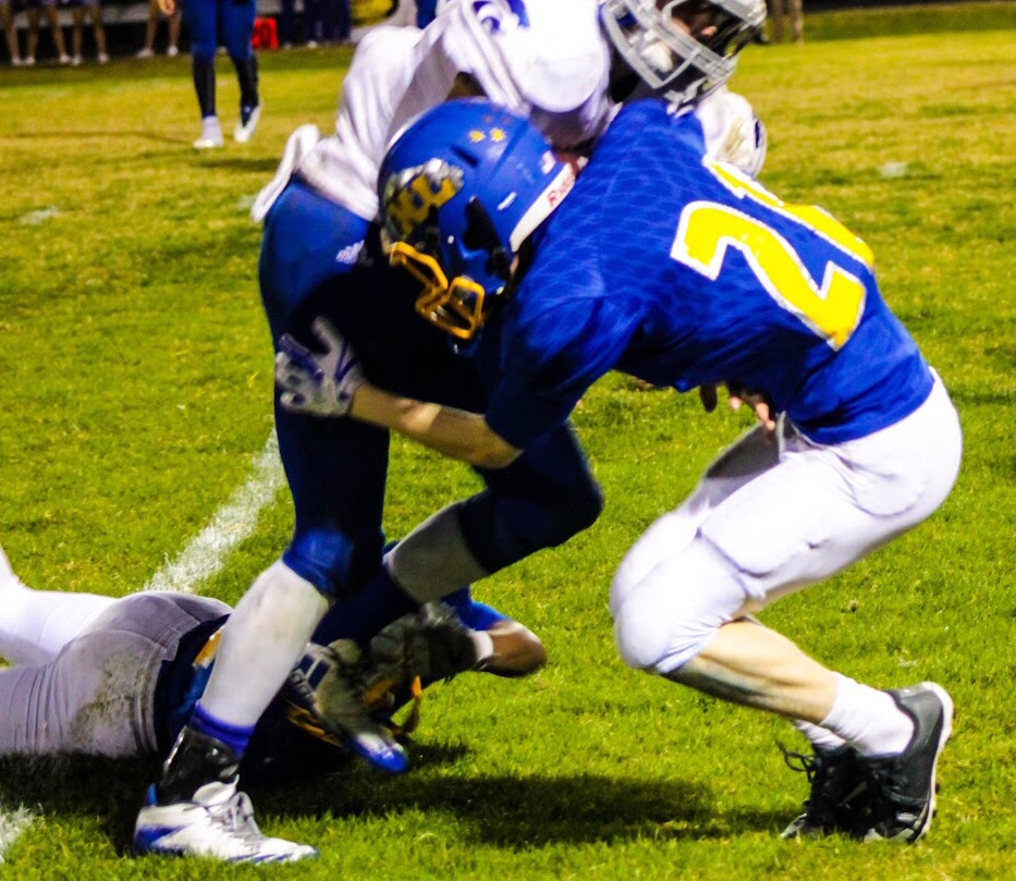 (photo by Lynn English) Grant Sulsar with a tackle