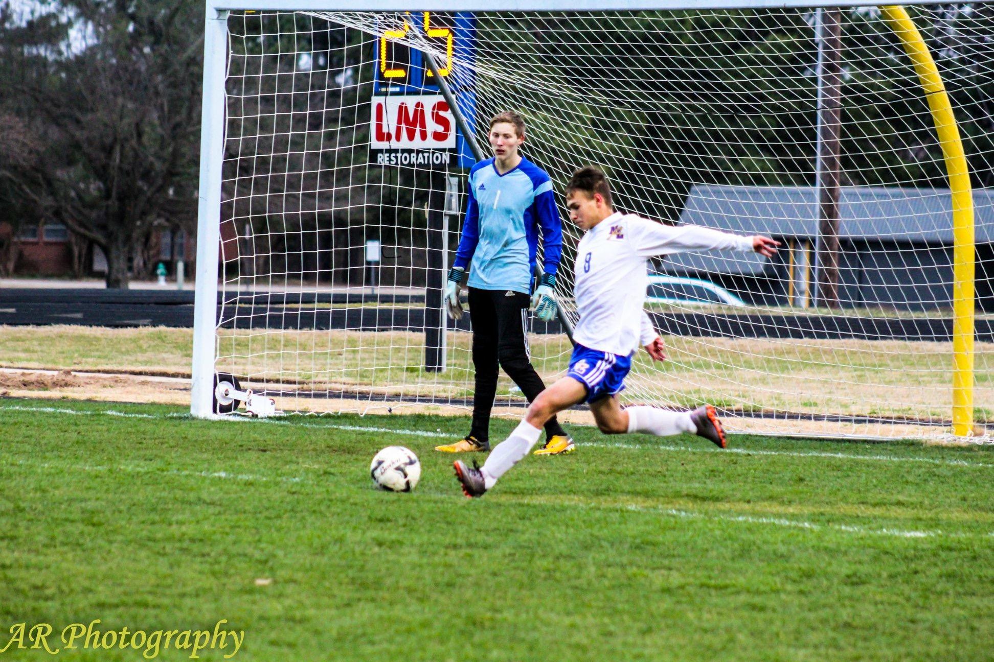 Aaron Meredith with a goal kick as Nick Kear looks on