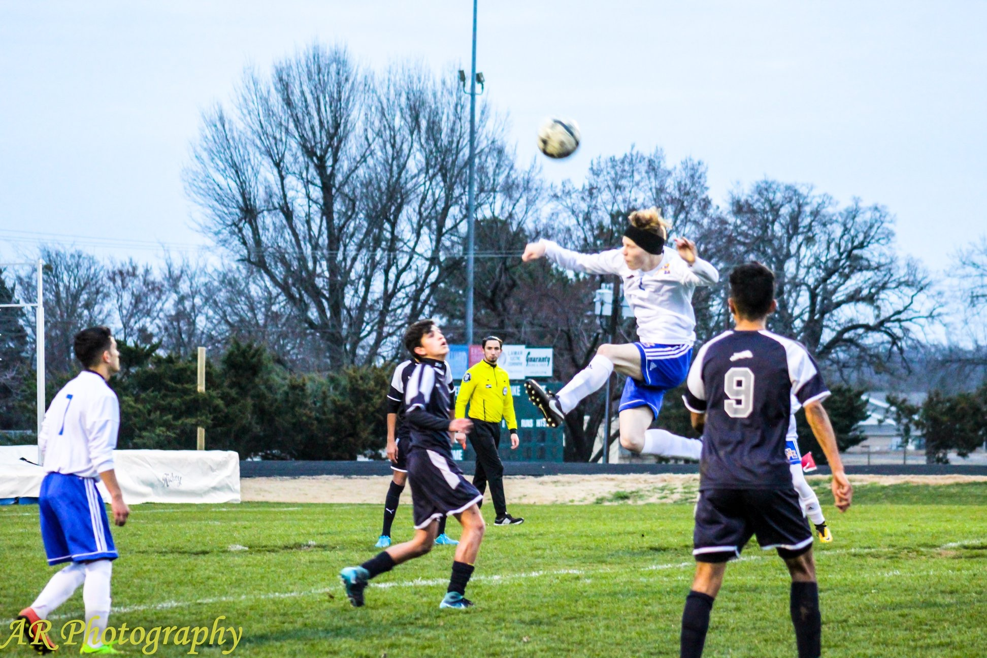 Grant Sulsar with a header in the Paris game