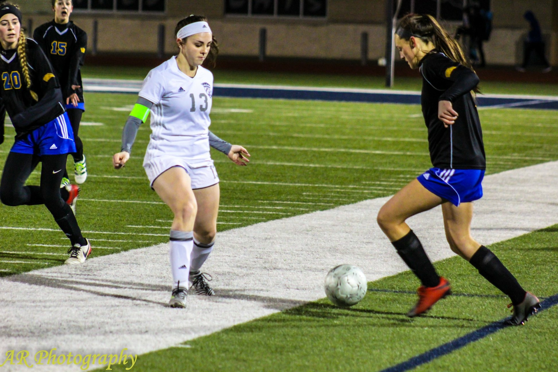 Macie Pointer faces off with a Paris player
