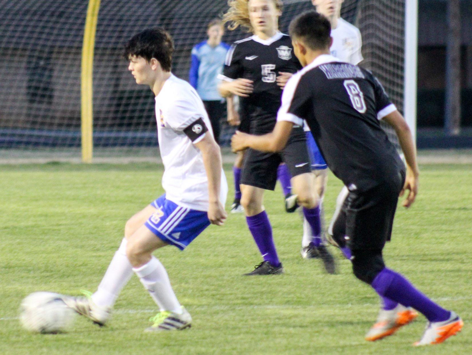 Matthew Meredith sets up a kick