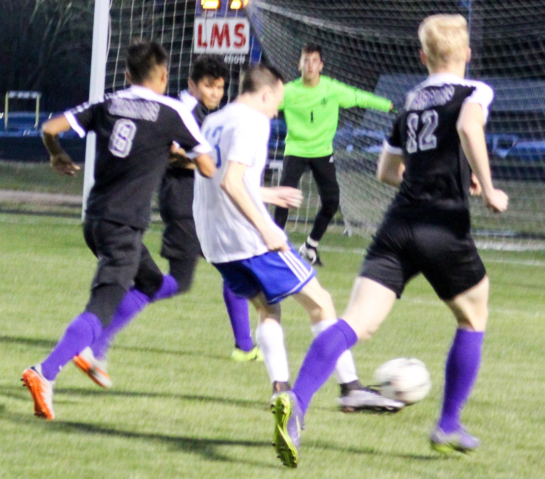 Jeremy Bolton takes a shot on goal