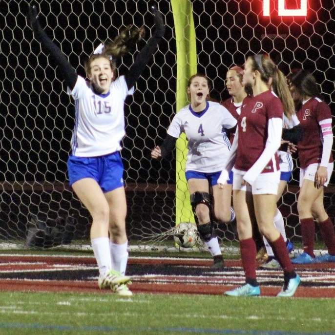 Said English and Reyna Hilliard celebrate a goal (Photo by Lynn English)