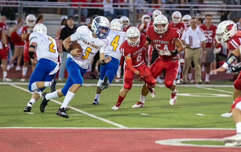 Photo by Kevin Watson: Trenton Smith (3) takes a handoff from Kobey Emeyabbi (2) against Pottsboro Friday night.