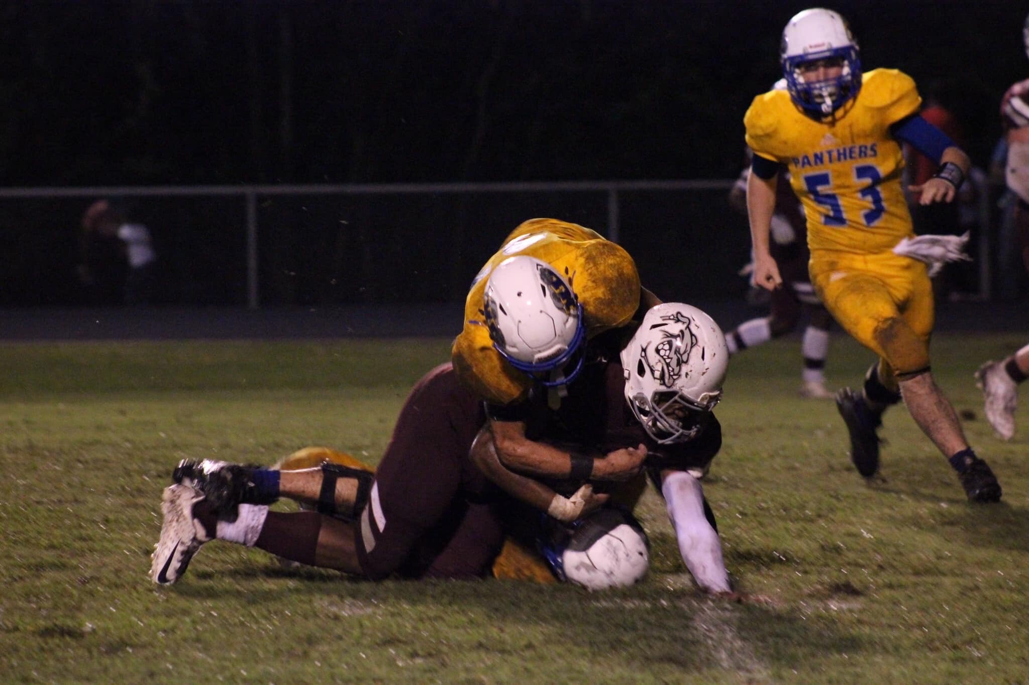 Photo by Lynn English: Mason Stephens with a tackle with Sam Creamer running to help.
