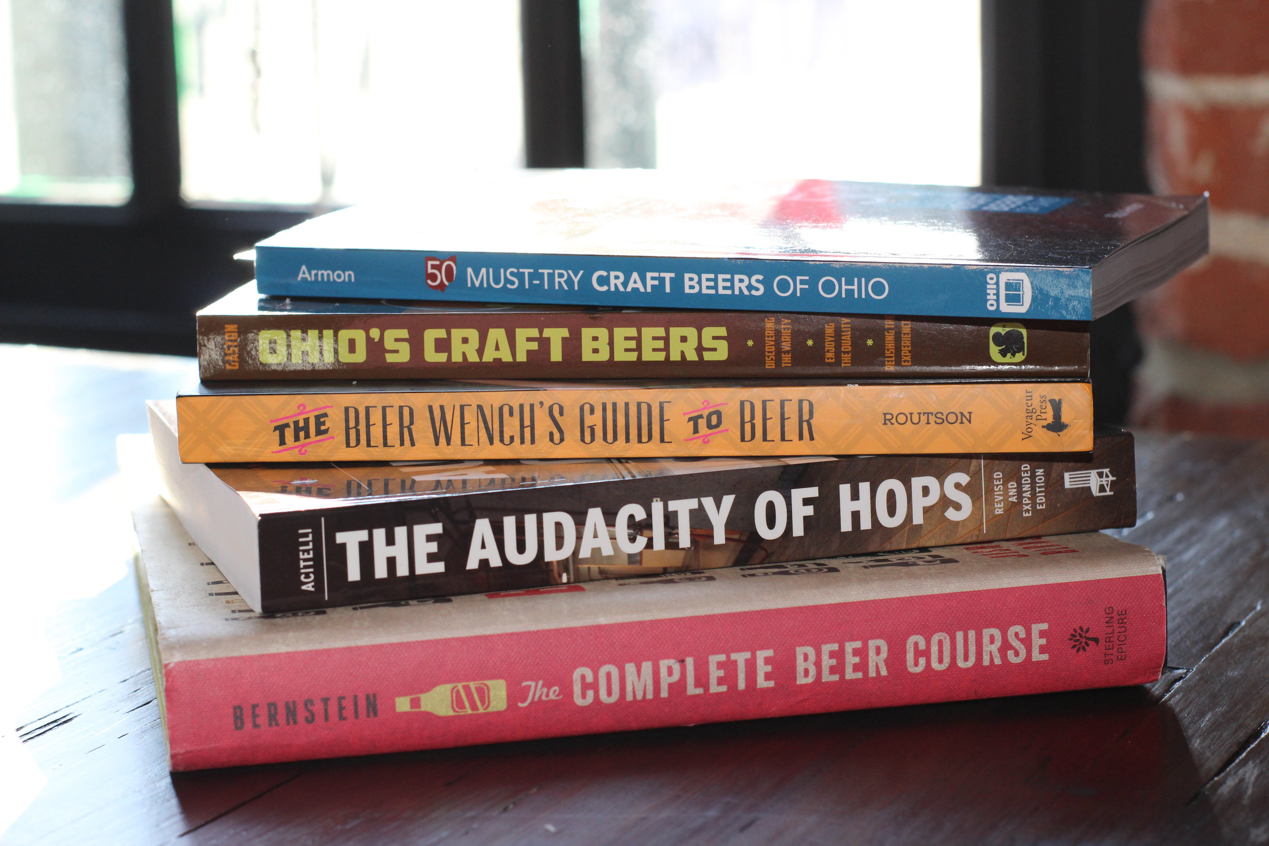 Main Street Books in downtown Mansfield has a number of beer related books that would be perfect.