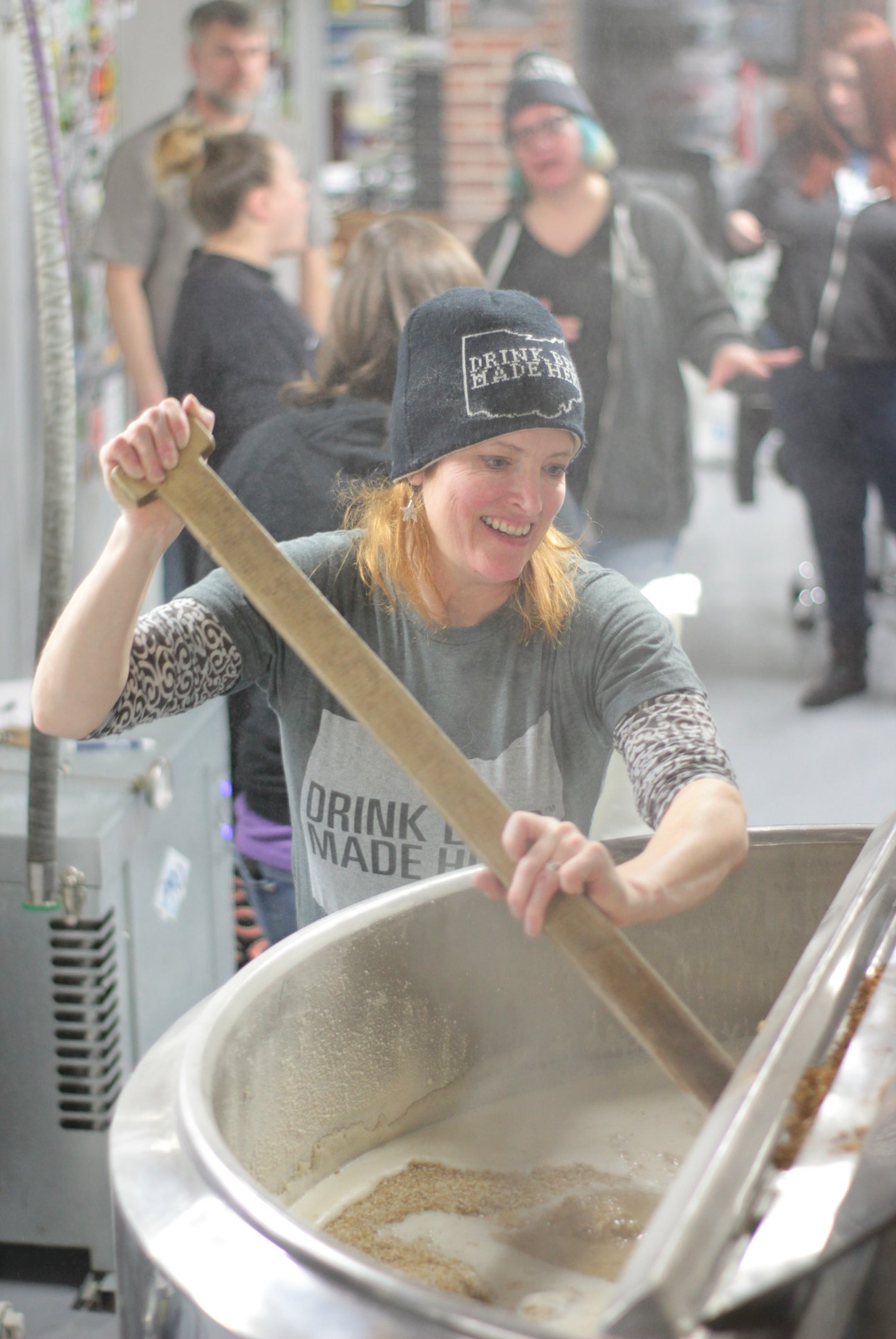 Mary McDonald, head of the Ohio Craft Brewes Association,  stirring the New E.R.A. mash.