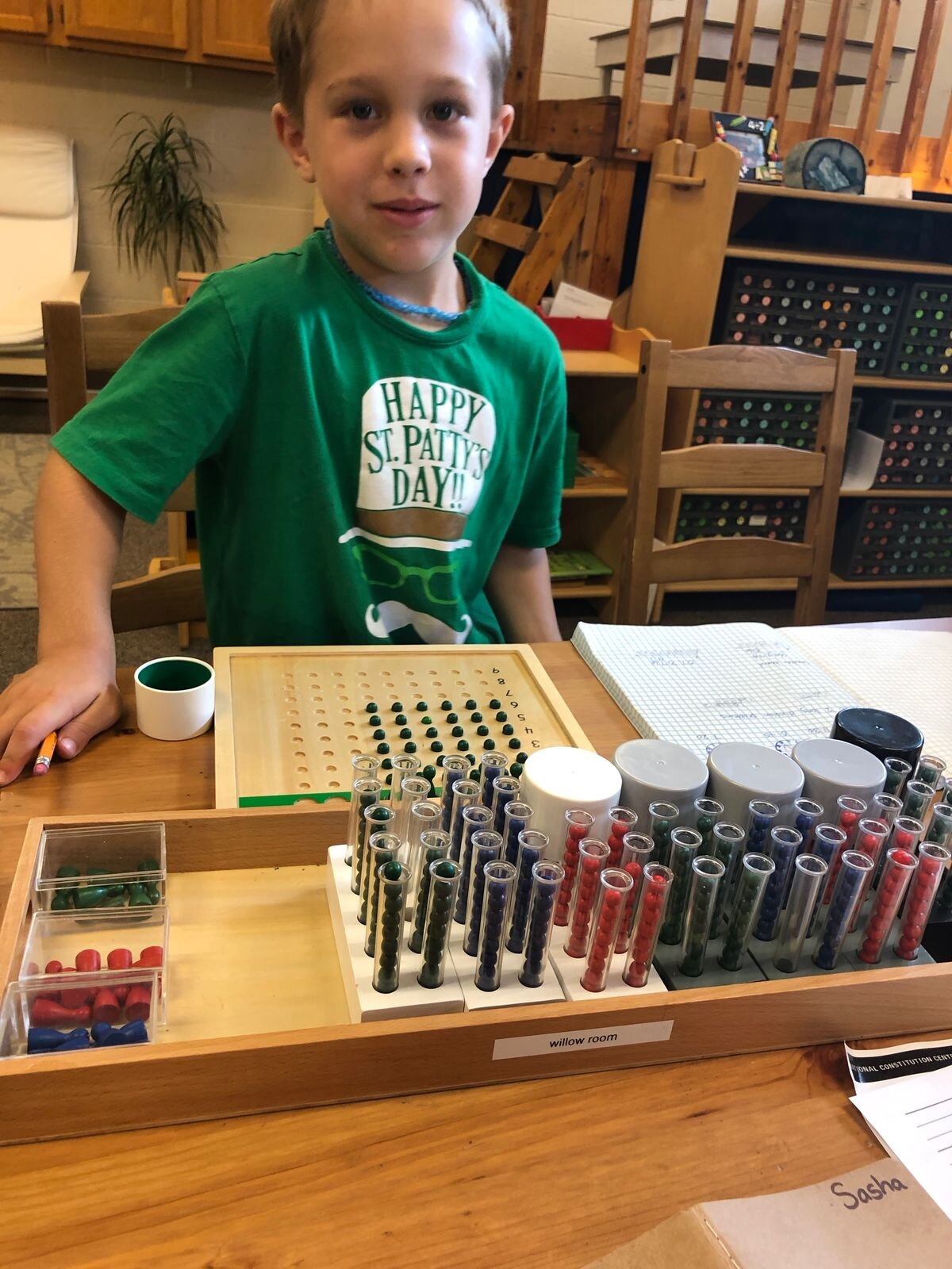 A second-grade student works on a division problem into the millions with the help of the Racks and Tubes. That's a lot of beads to keep track of!