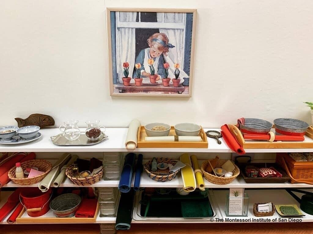 A Practical Life shelf demonstrates the precise order of the materials starting with the simplest on the top left to the most complex on the bottom right. Isolated skills are practiced repeatedly and incorporated successfully into the works with more complex steps. (Photo credit to  Montessori Institute of San Diego )