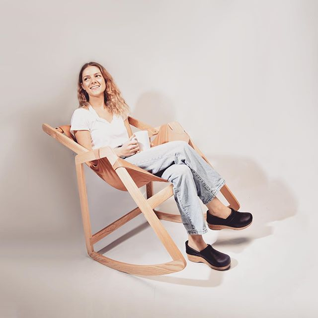A great place to relax and enjoy a warm cup of tea ❤️ thanks @gracemknight for modeling the carter chair! #cozy #industrialdesign #furnituredesign #chairdesign #risd #woodwork #rockingchair