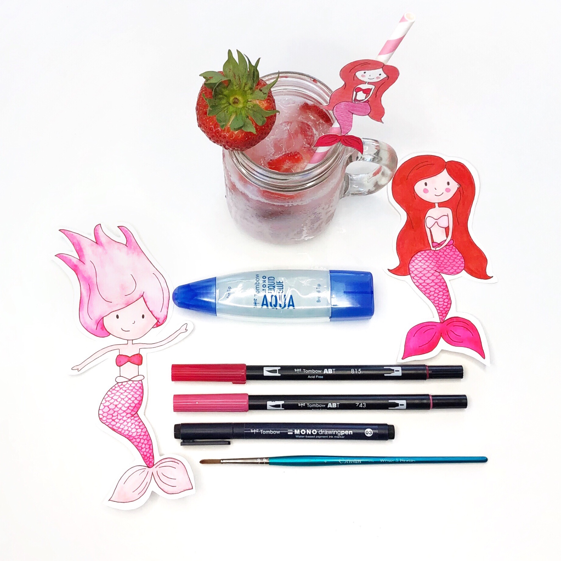 How to make your own drink umbrellas, mermaid straws, and strawberry drink toppers by Jessica Mack of BrownPaperBunny