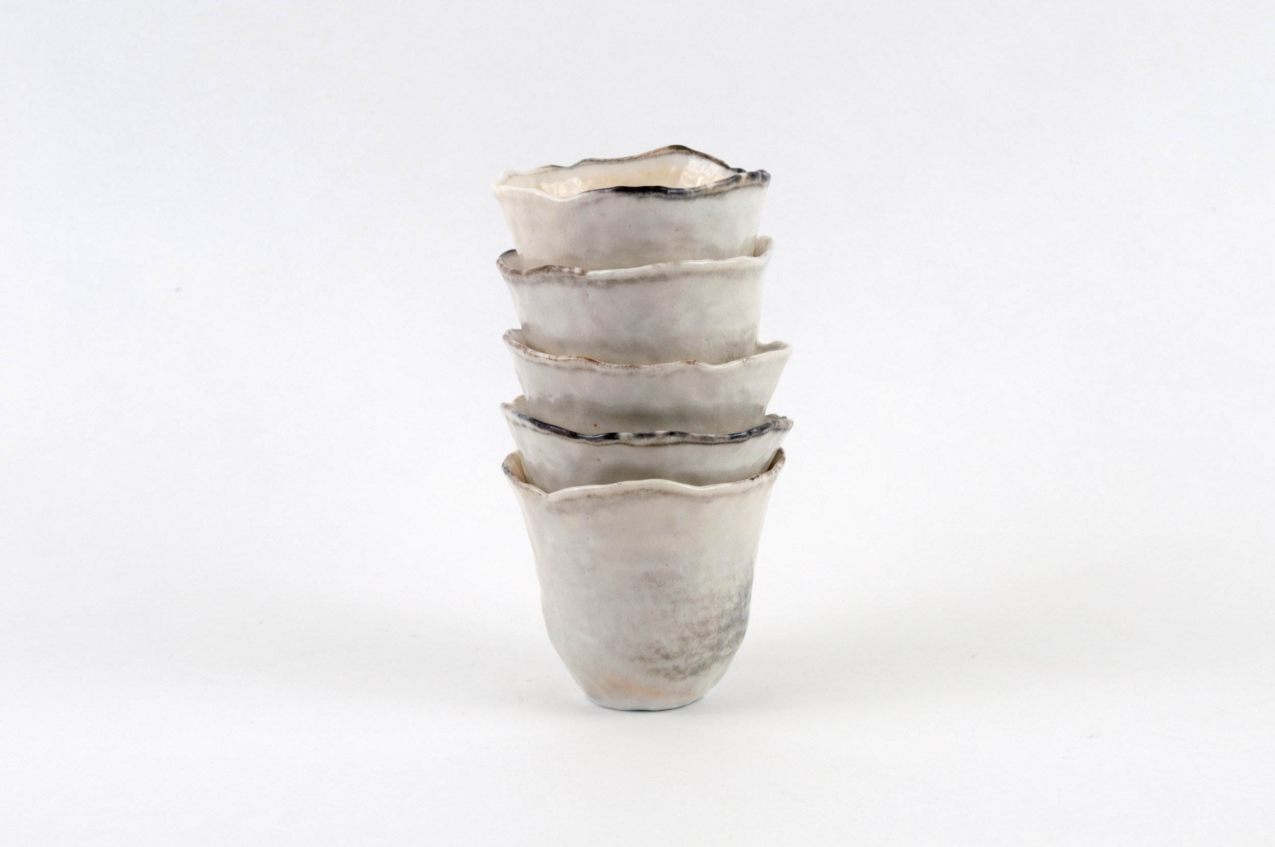 Five tumblers  Porcelain, shino glaze, 2018