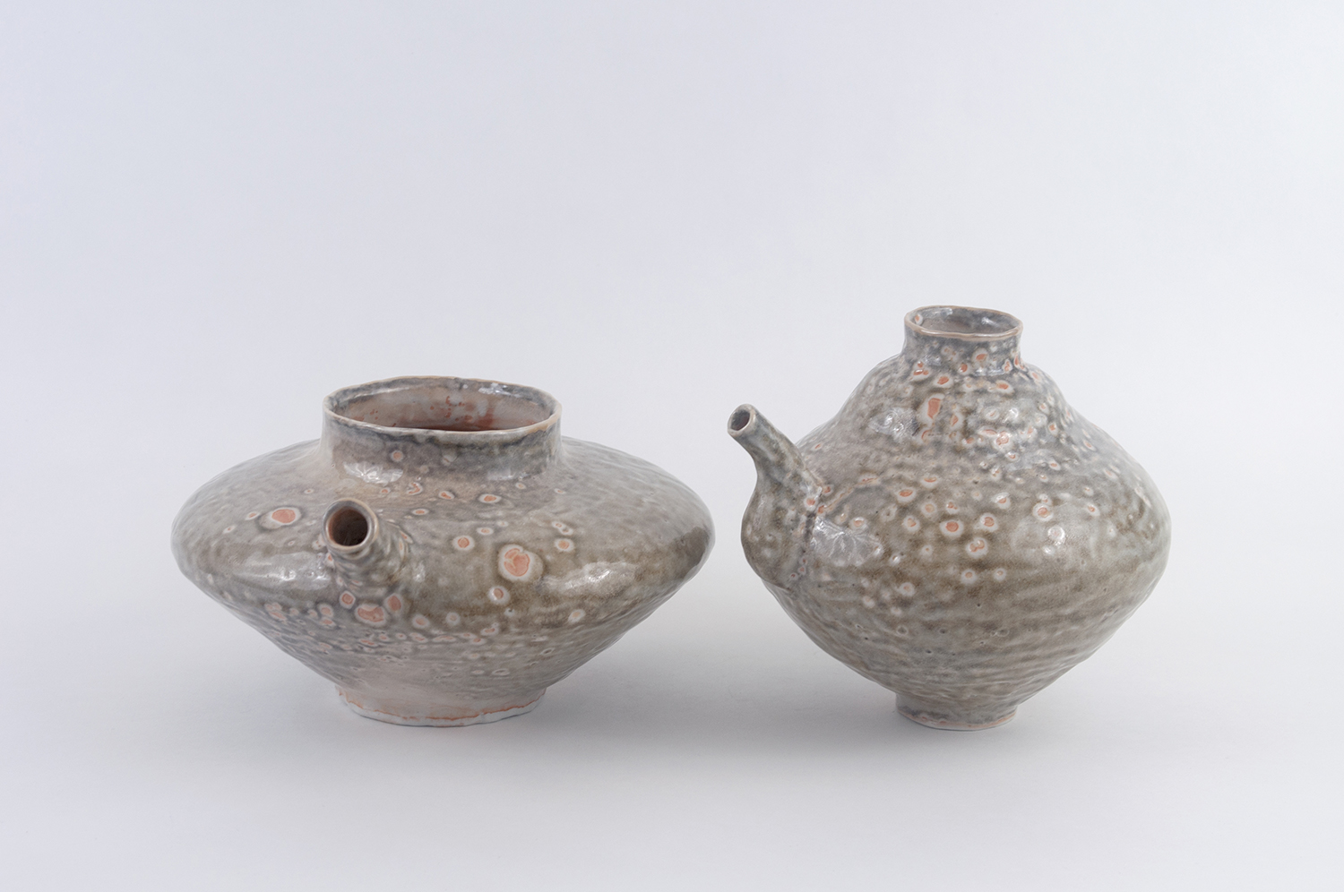 Two Spouted Pots  Porcelain, shino glaze, 2018