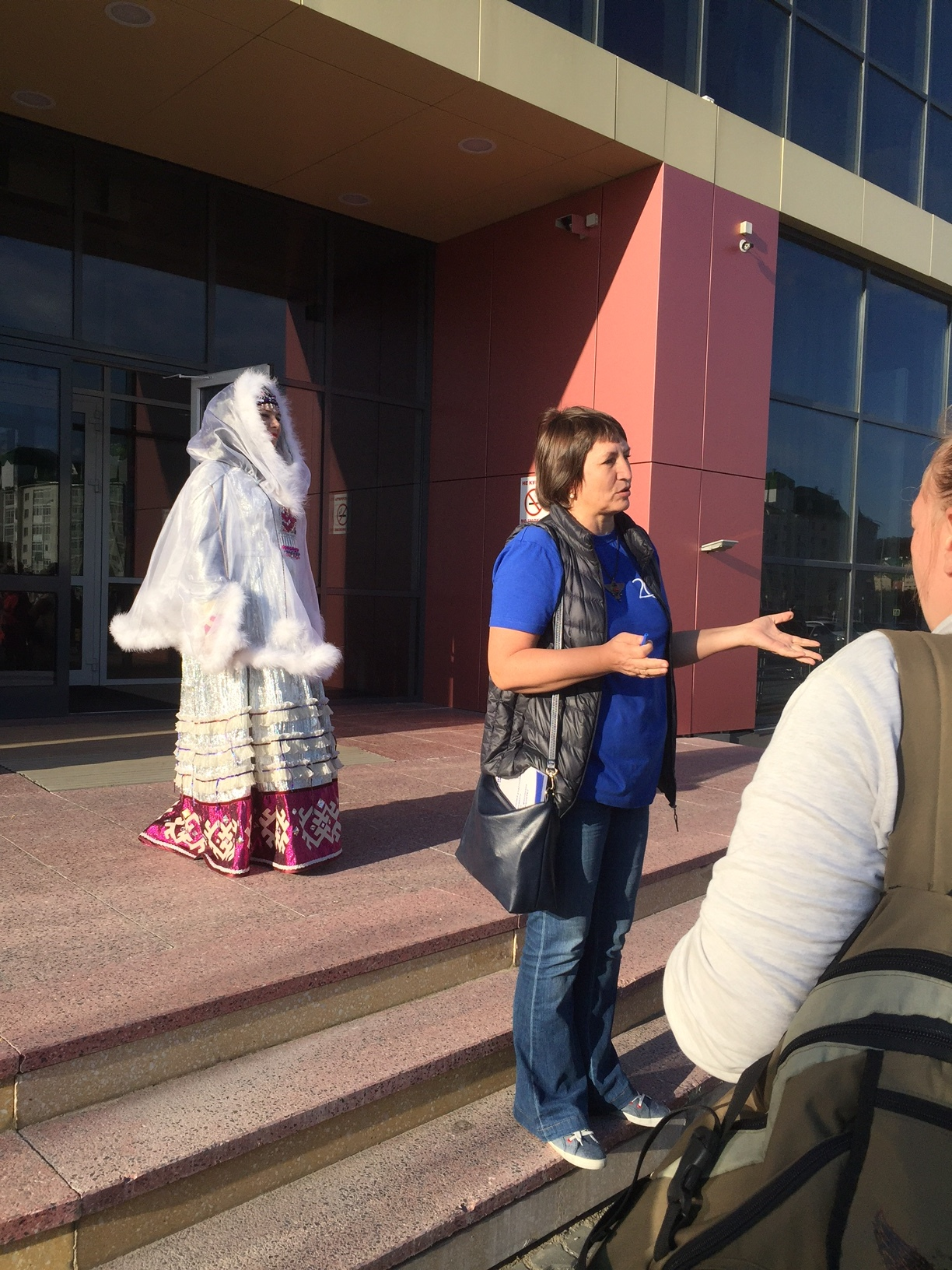 Our hostess, organizer of the festival, Tamara Sutyagina, greeting us as we arrive for a reception hosted by Mayor Maksim Ryashin. A woman in indigenous ceremonial costume stands by.