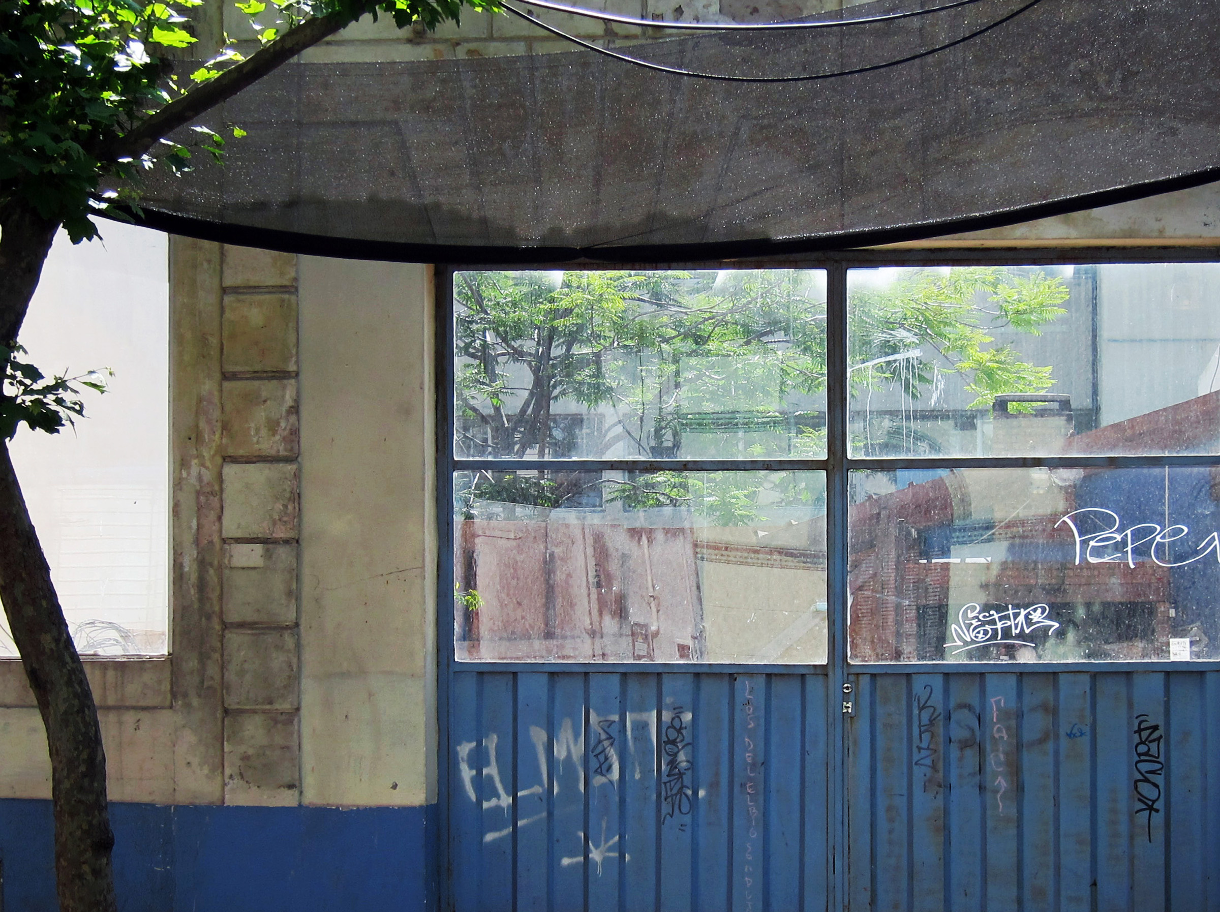 Montevideo view through plastic to storage courtyard a.jpg