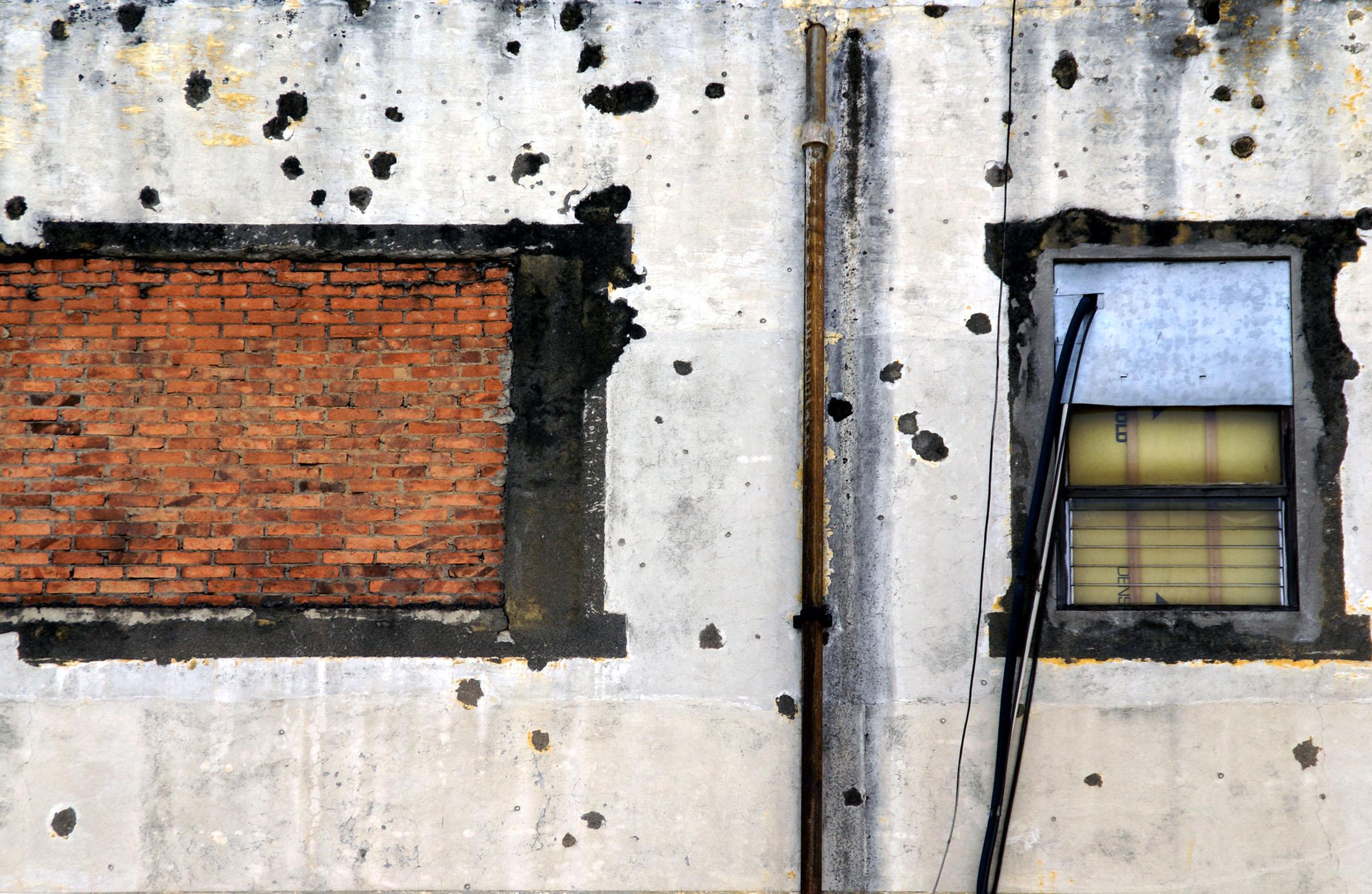 7 San Jose pockmarked wall w windows.jpg