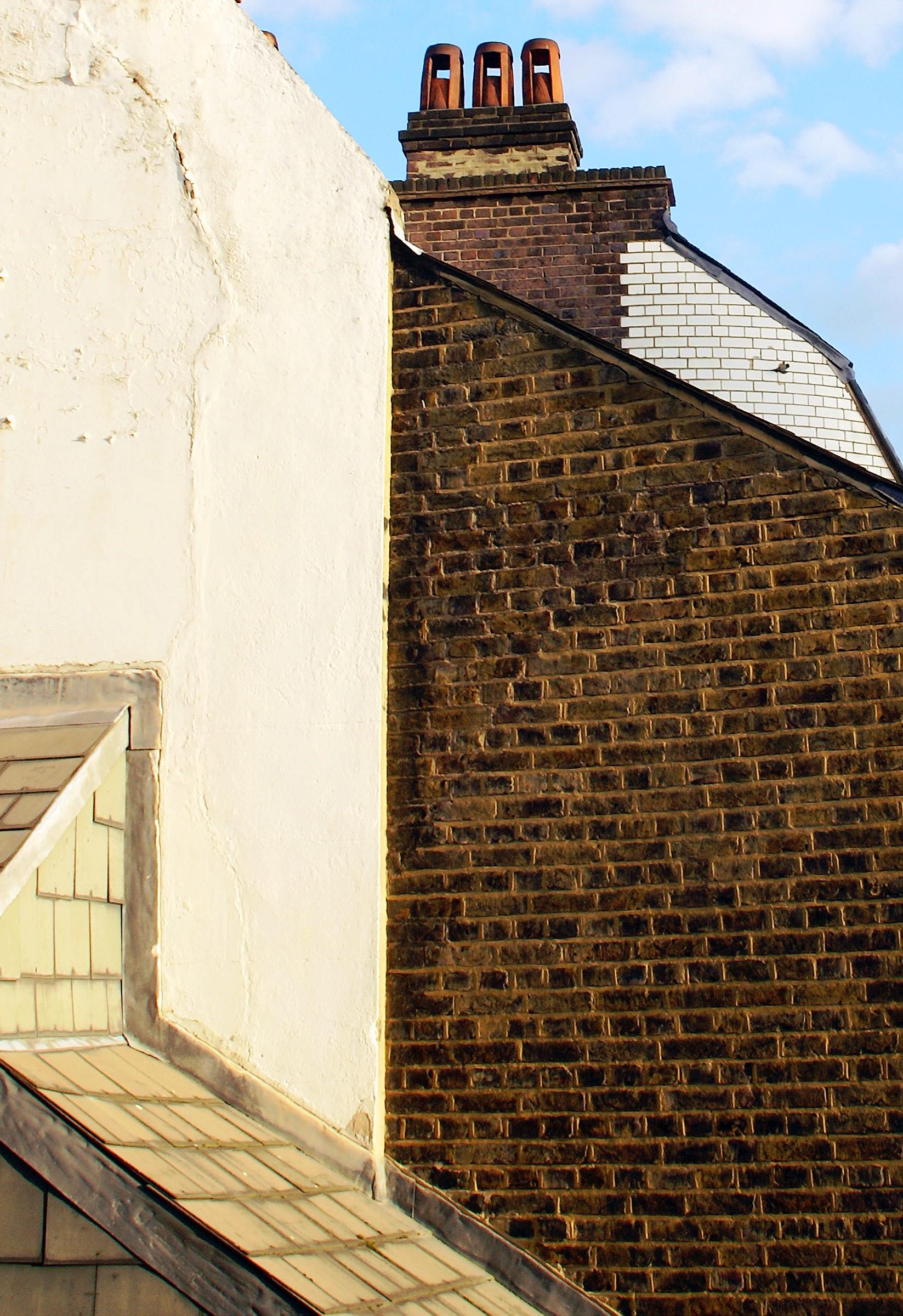 London brick and shingle walls windowless.jpg