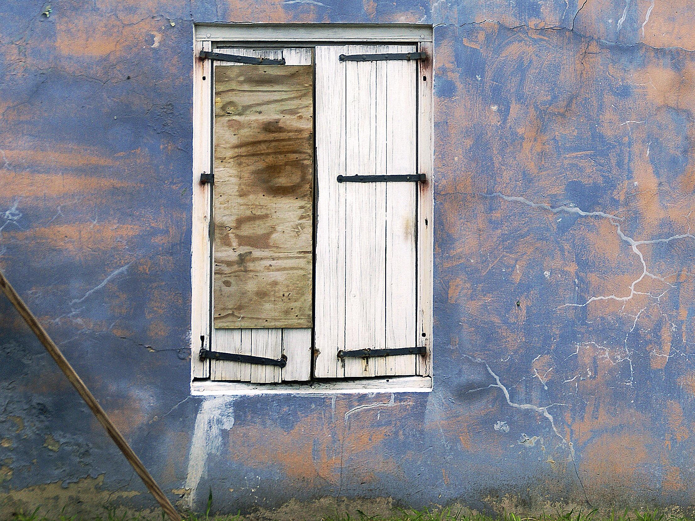 Stockholm blue wall w white shutter repaired.jpg
