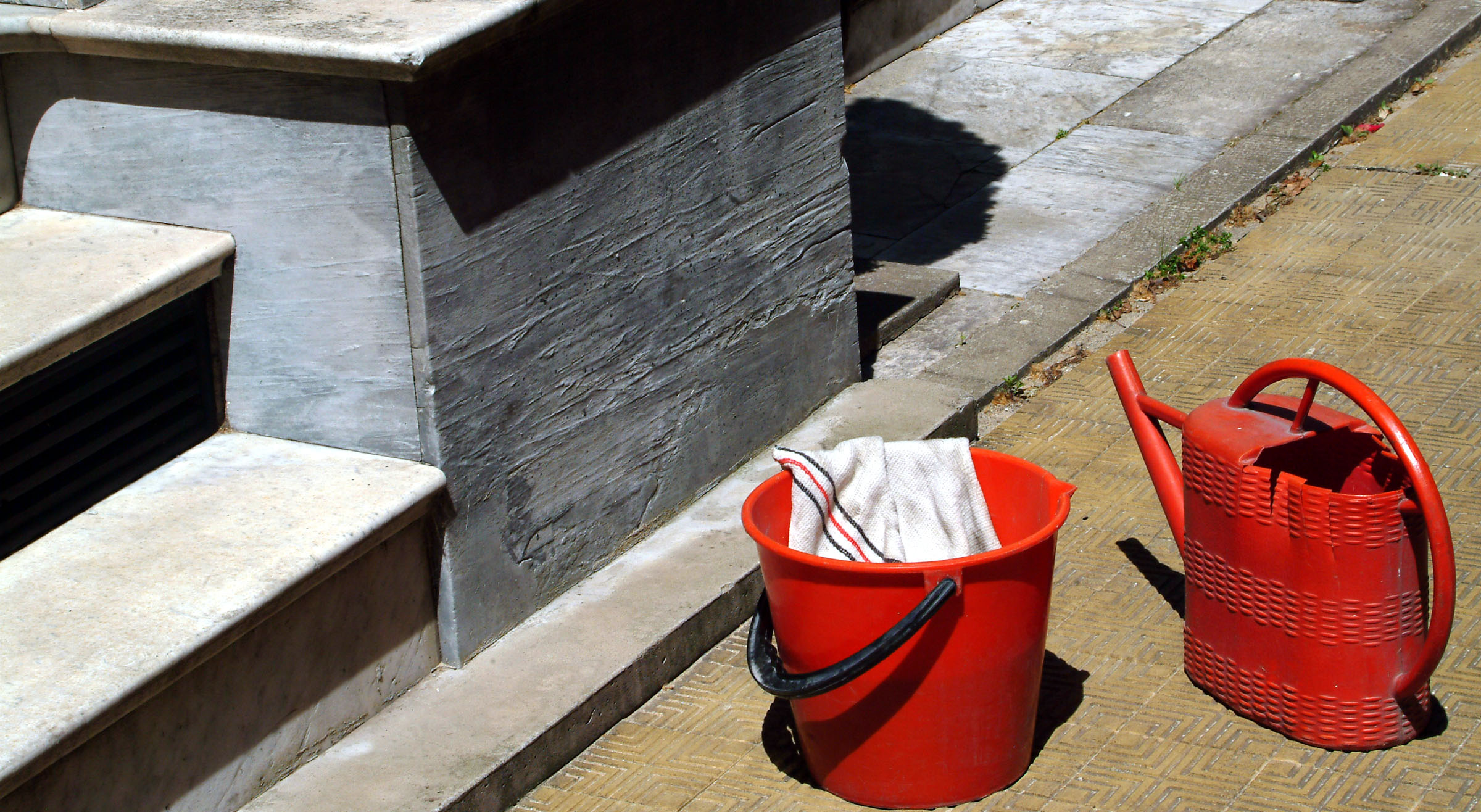 red bucket and watering can.jpg