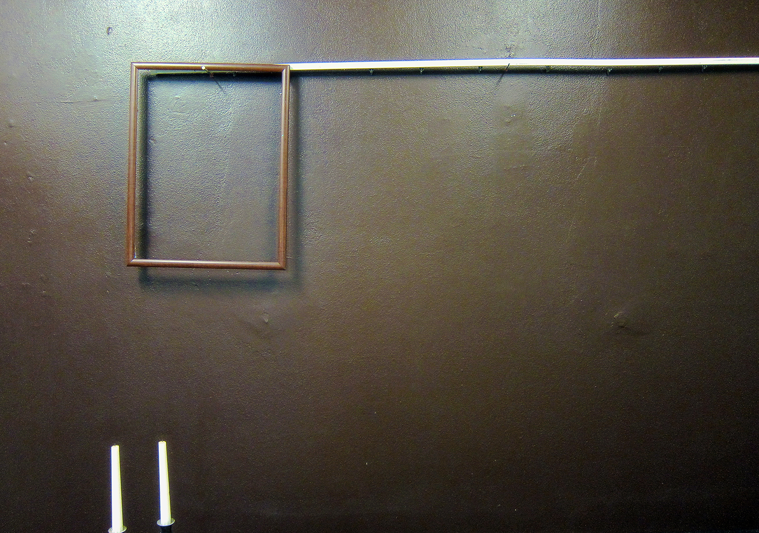 x Loop 9 image 3 empty frame on wall two candles 3.jpg