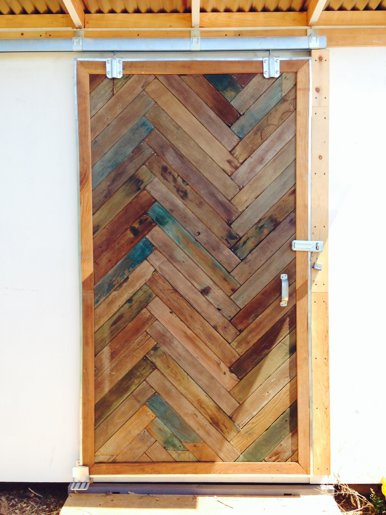 The wood to make this door was obtained from the Oxford Tract Greenhouses at UC Berkeley.