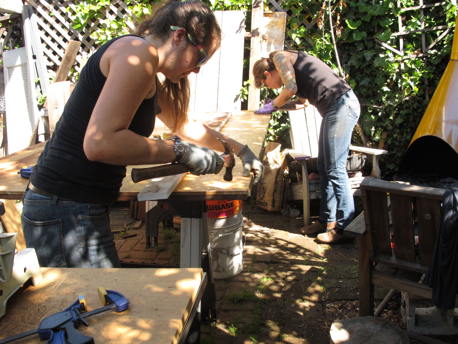 Maggie & Ellie reinforcing the backside of the door with screws, to ensure the mosaic wood front stays in place.