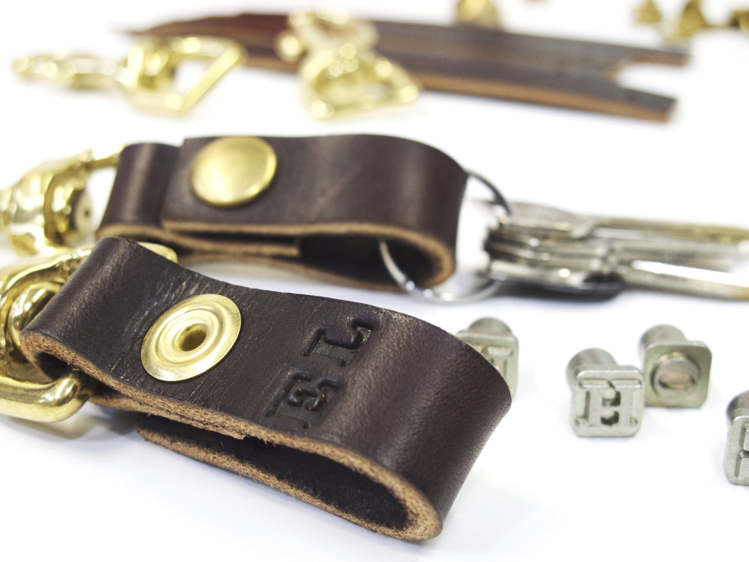 brown leather key holder with stamps 2.jpeg