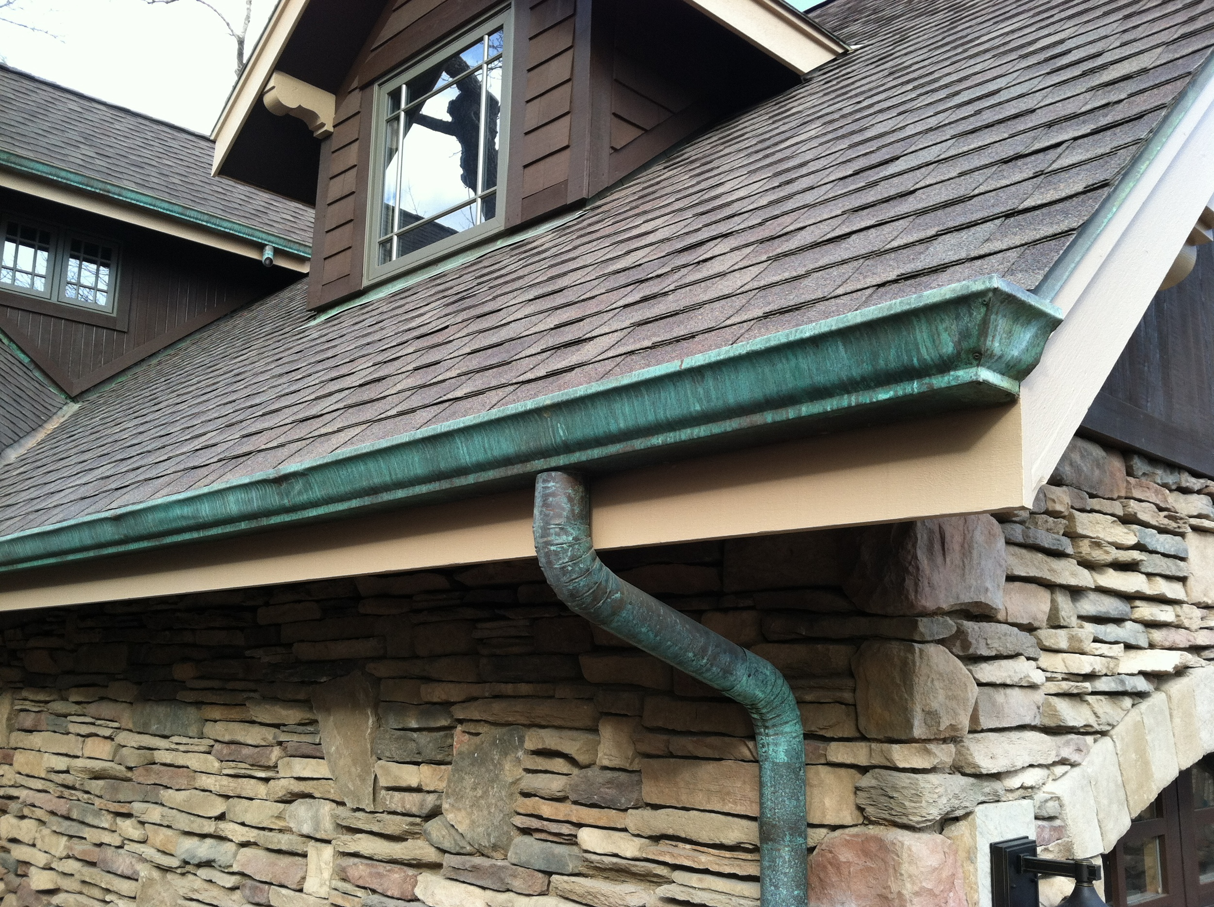 Copper Gutter with Patina Application