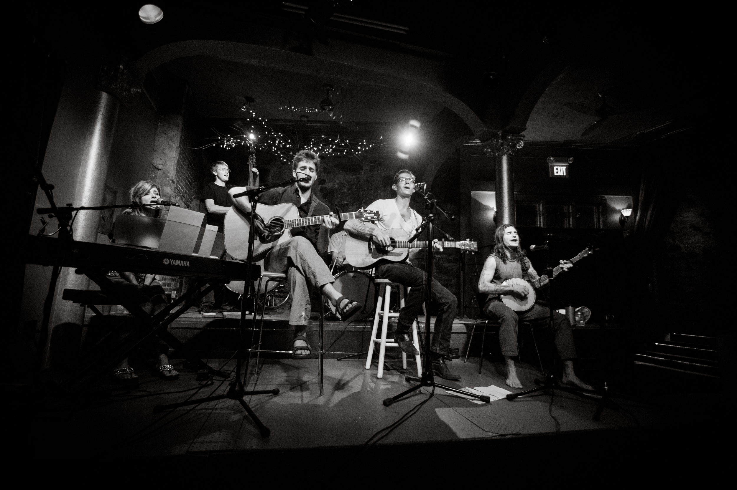 Jacob (far right) playing with his mother, Robin (far left); brother, Jordan (second from left); and fellow musician, Adam Cox (second from right).