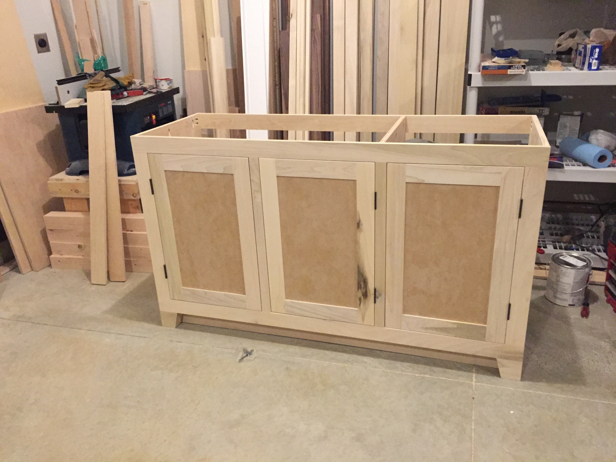 Shaker doors are attached and fitted.