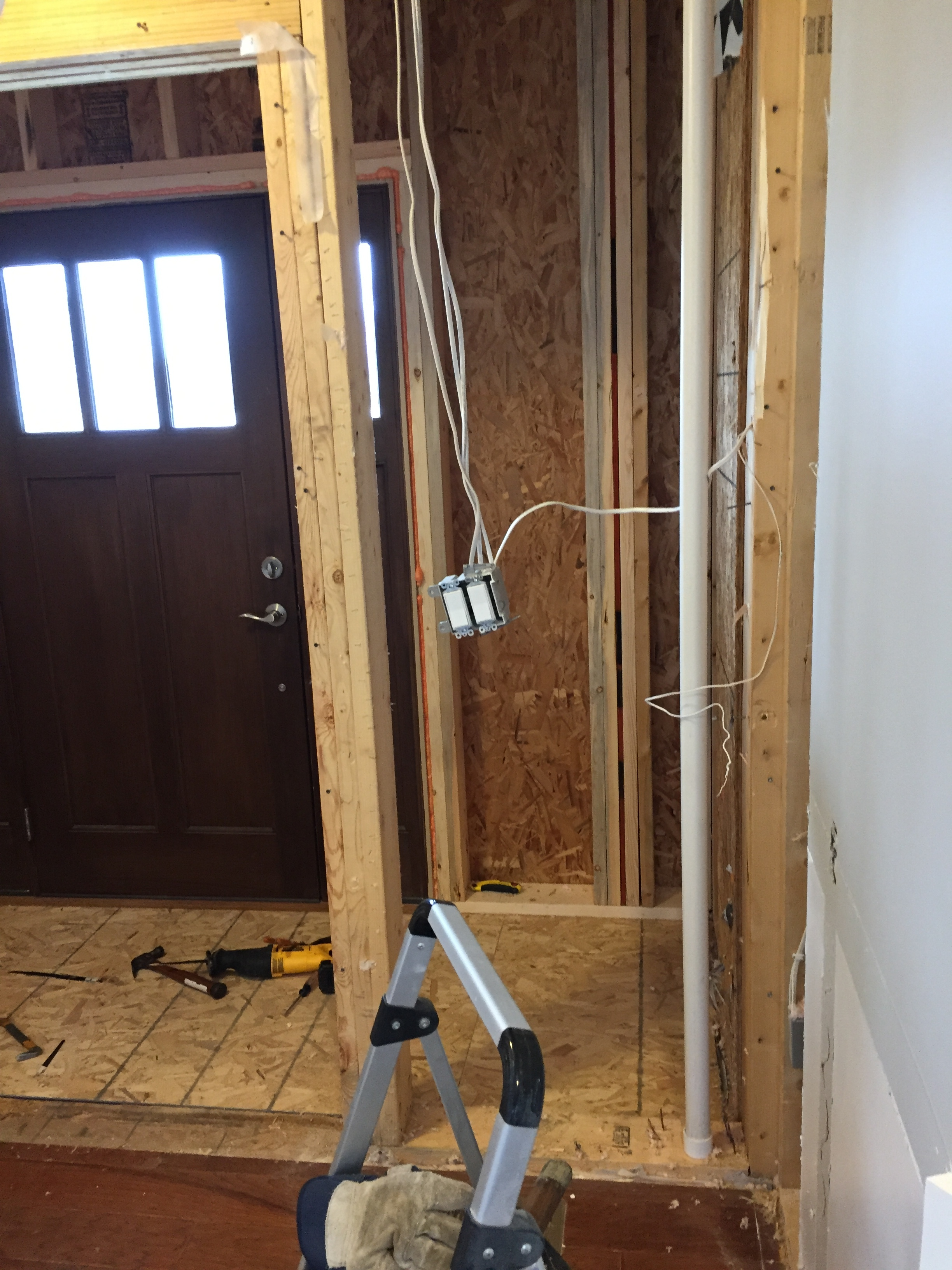 Removing the interior studs, electrical and plumbing from the entryway