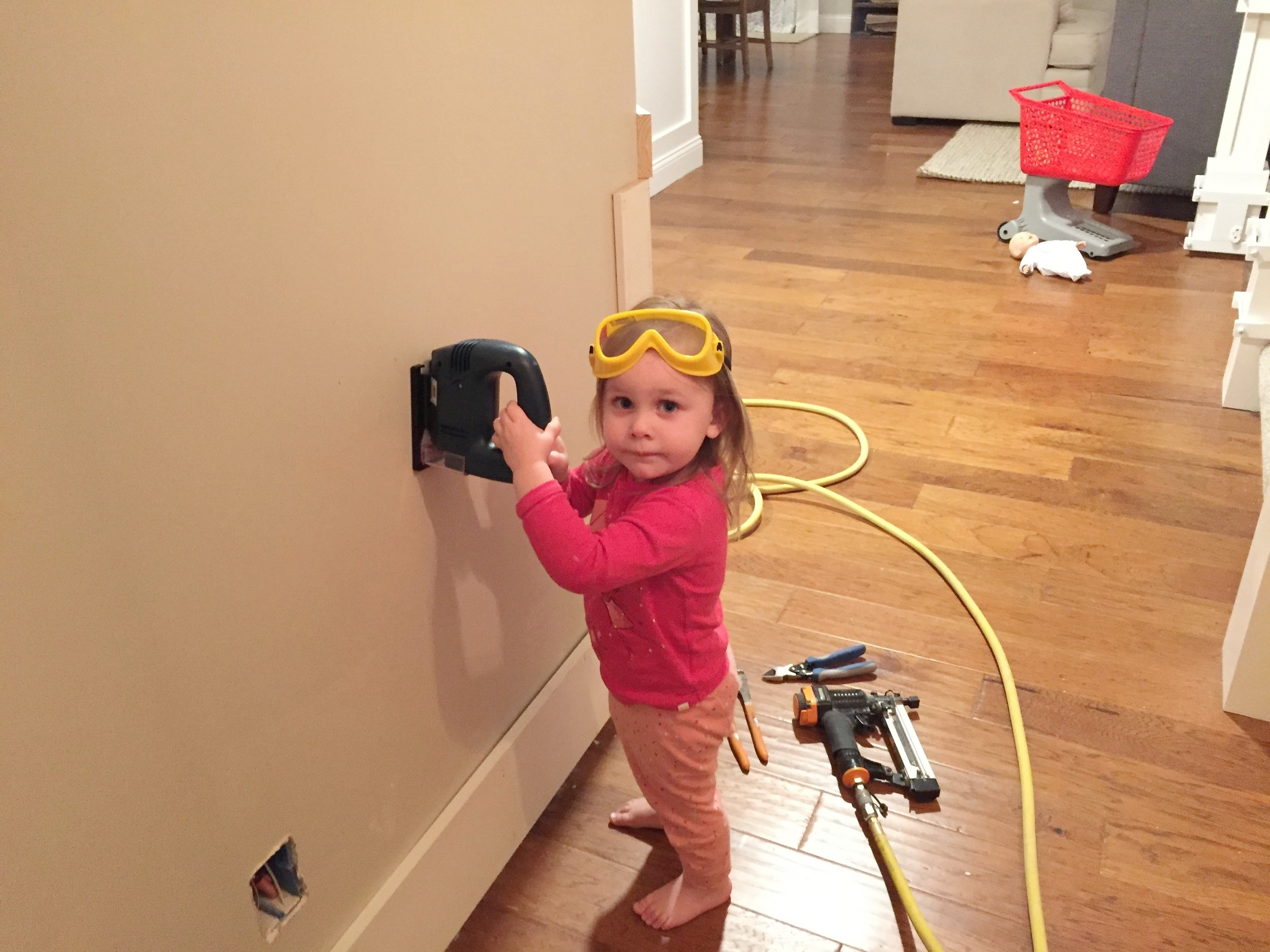 My little girl helping install wainscoating