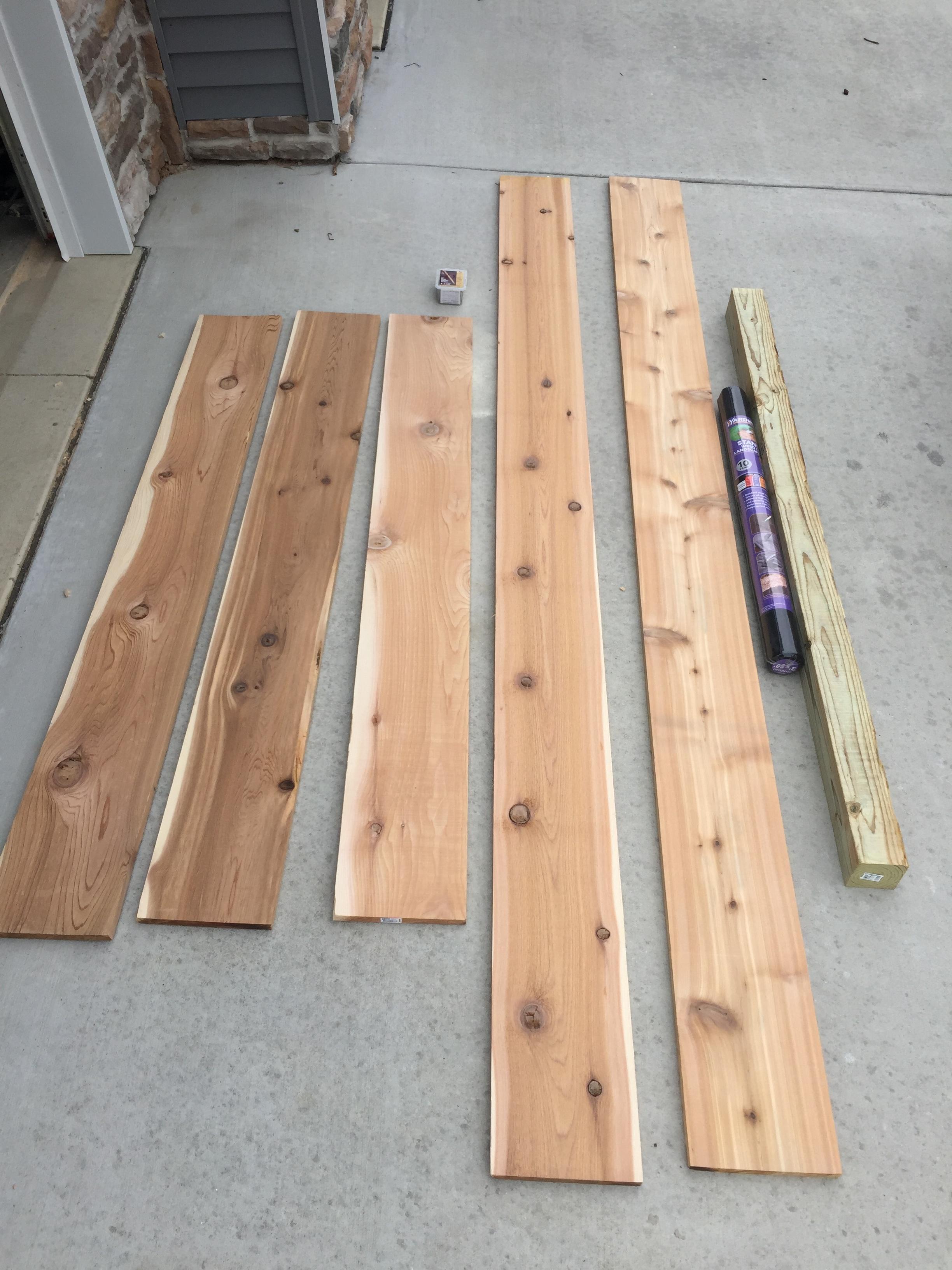 Cedar boards, screws, weed fabric