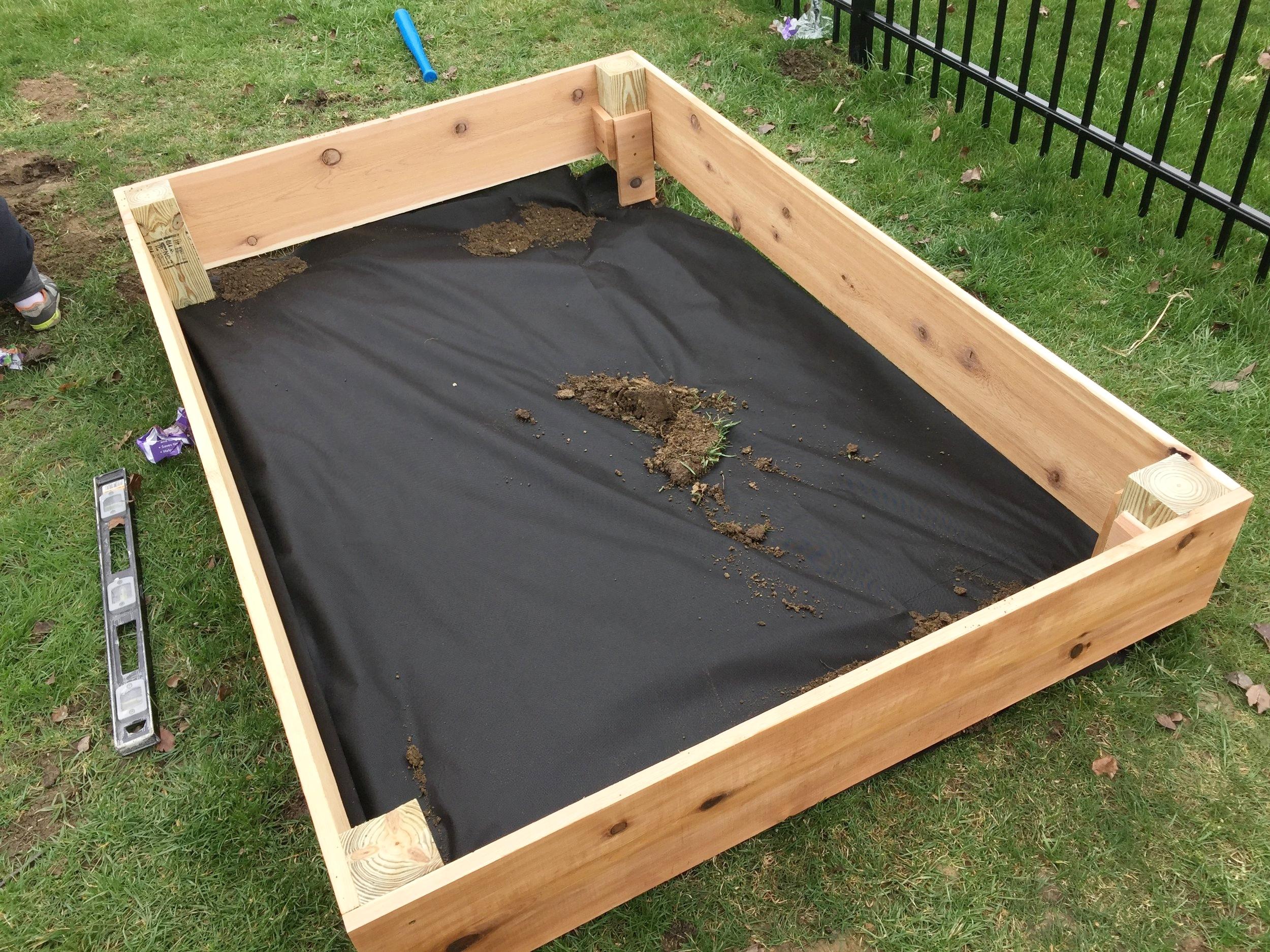 Cedar garden box with the weed control fabric