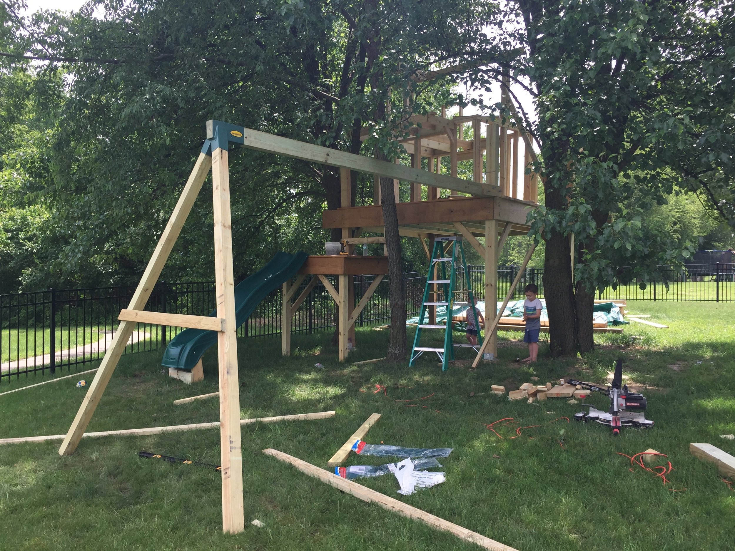 Swing set attached to a treehouse