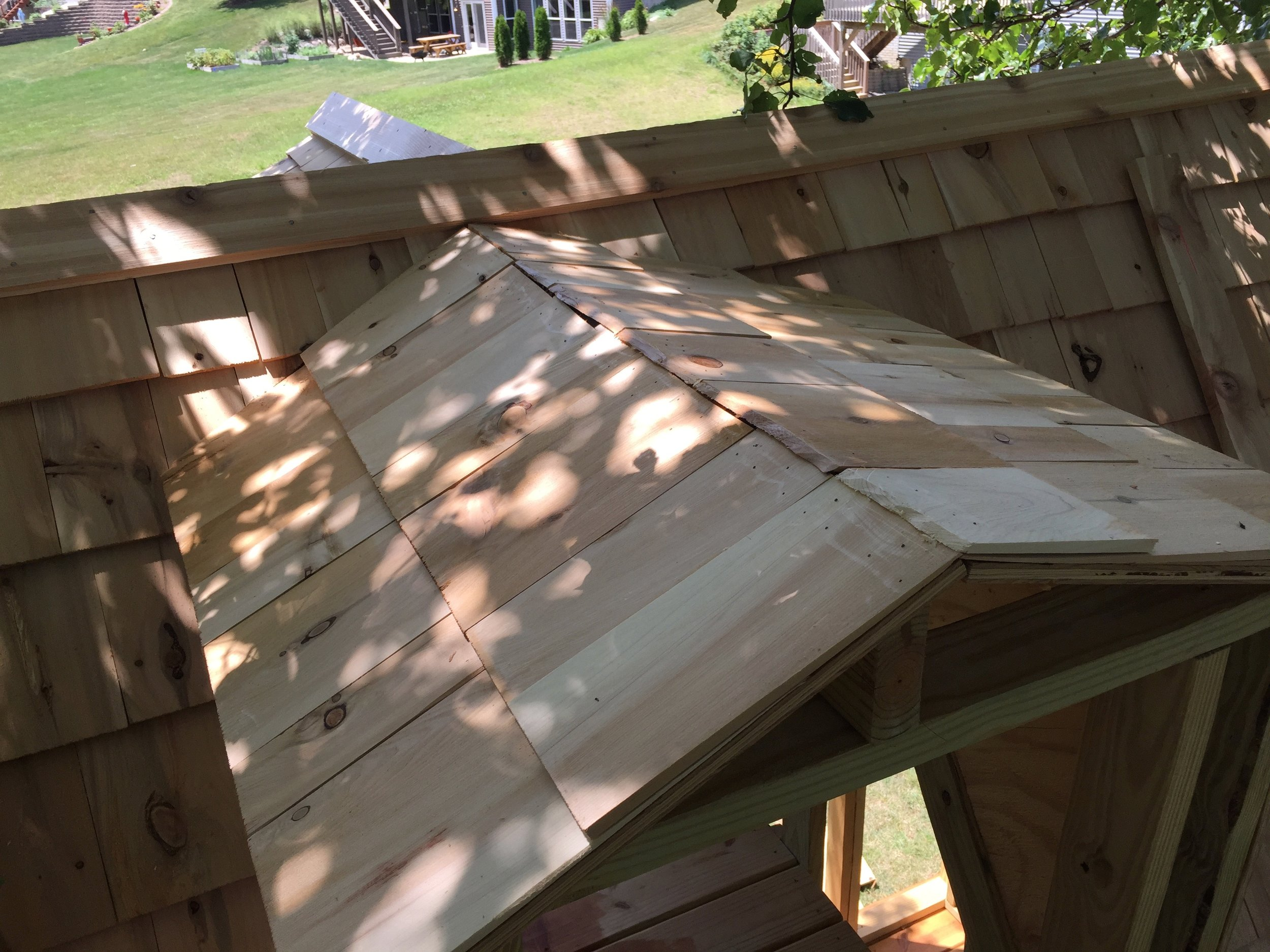 Final Layer of Cedar Shingles on the treehouse clubhouse roof