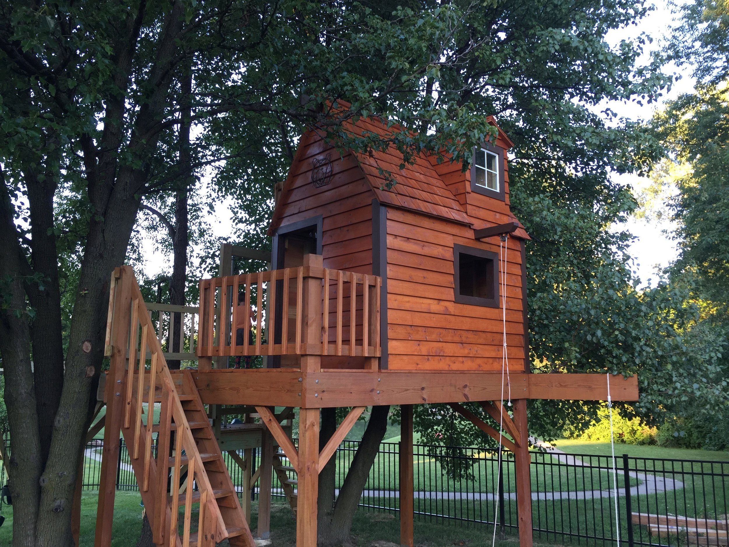 Clubhouse Treehouse with cedar roof and siding stained