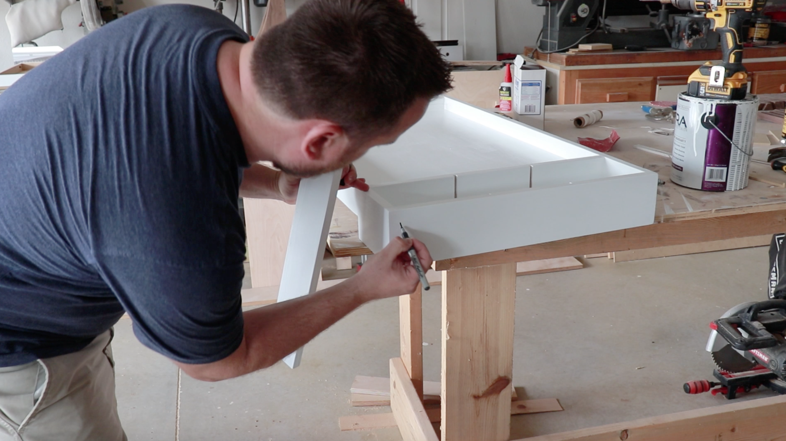 Installing the legs to the Lego table. Marking the side to keep track of the legs.