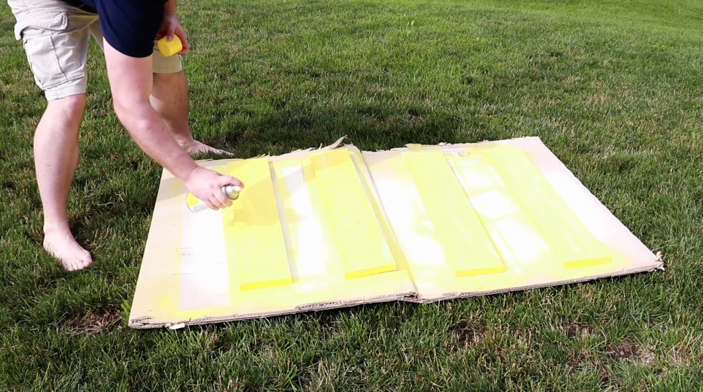 Spray painting the lemonade stand yellow