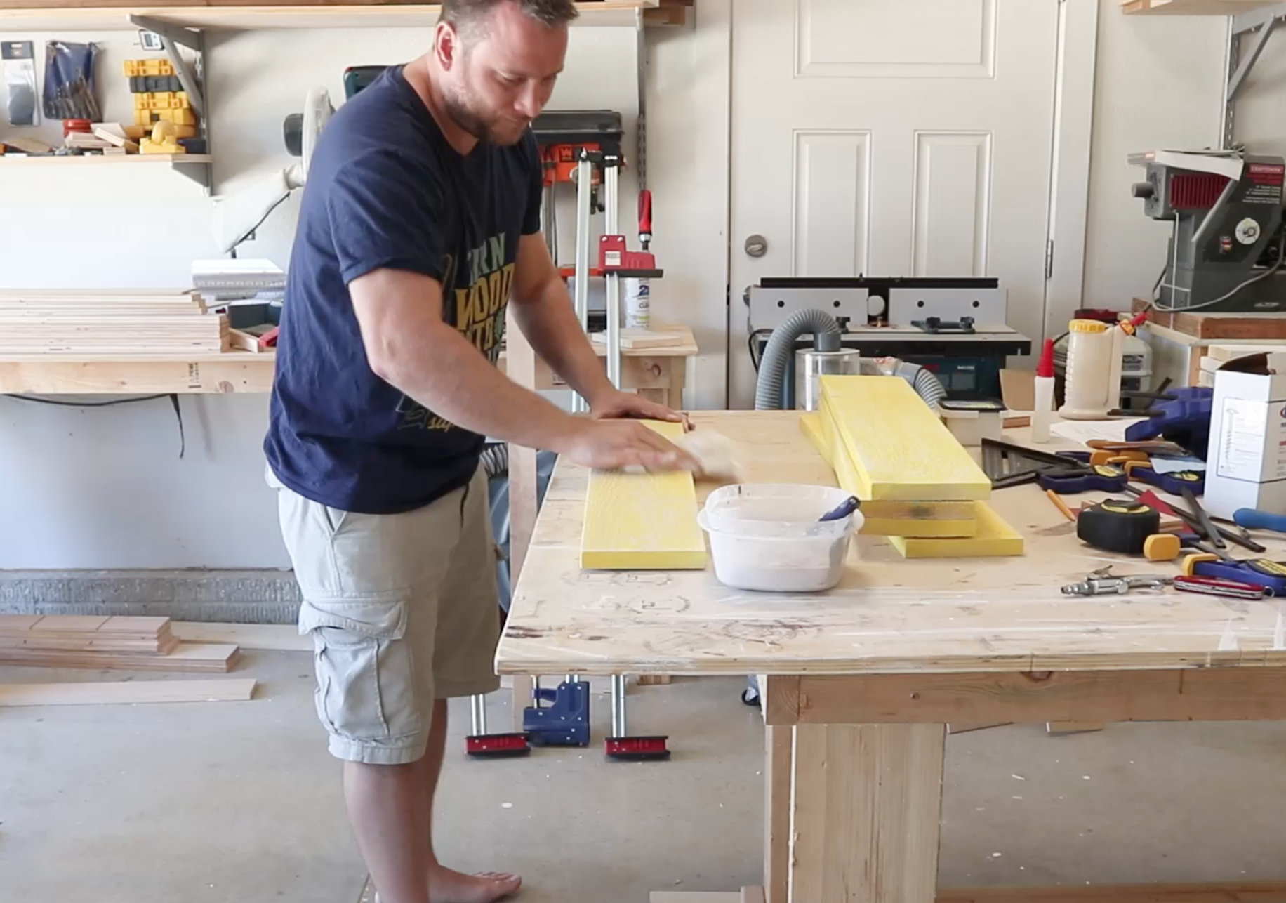 Applying a rustic weathering mixture to the lemonade stand