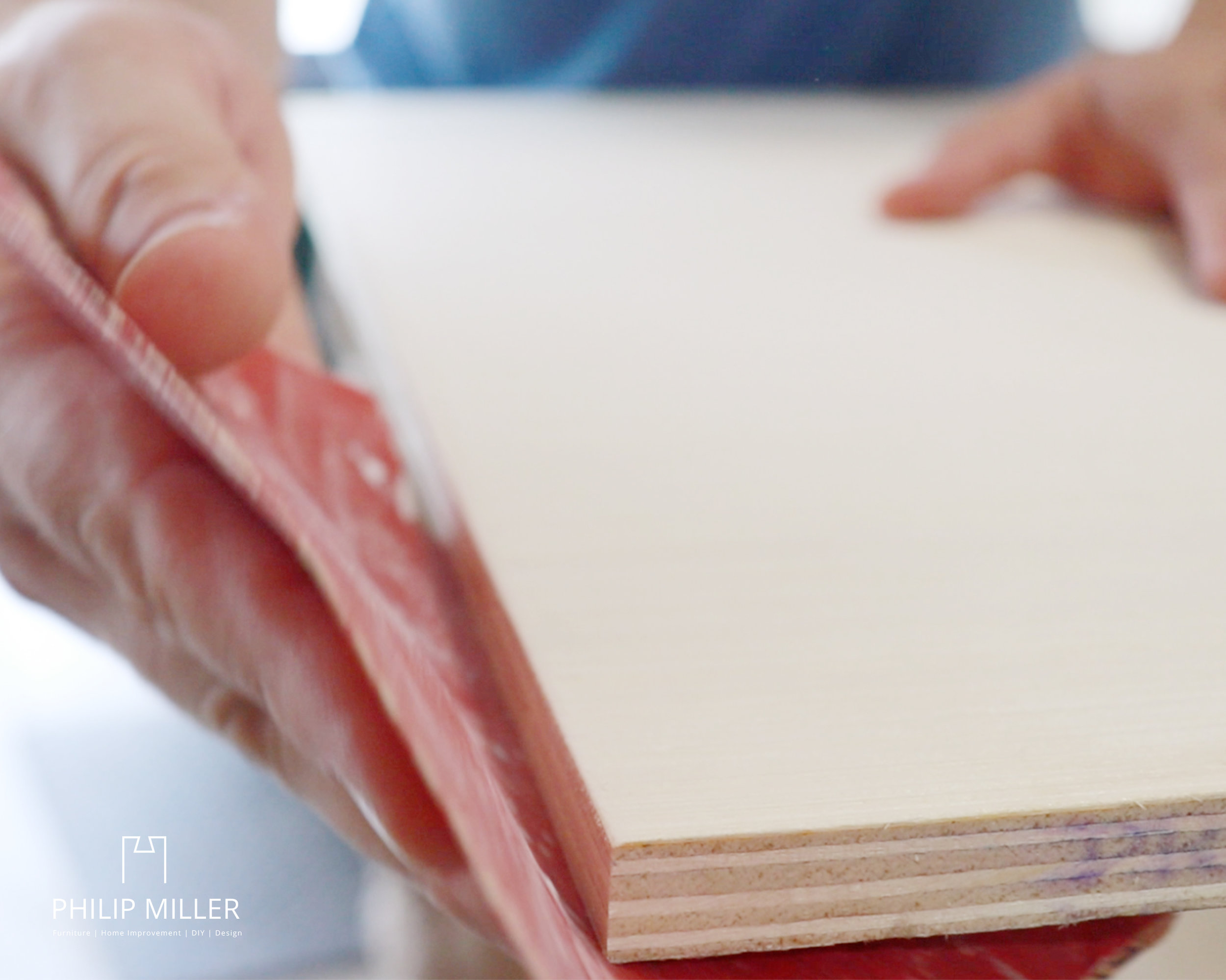 sanding and breaking the edges of the half inch plywood with sandpaper