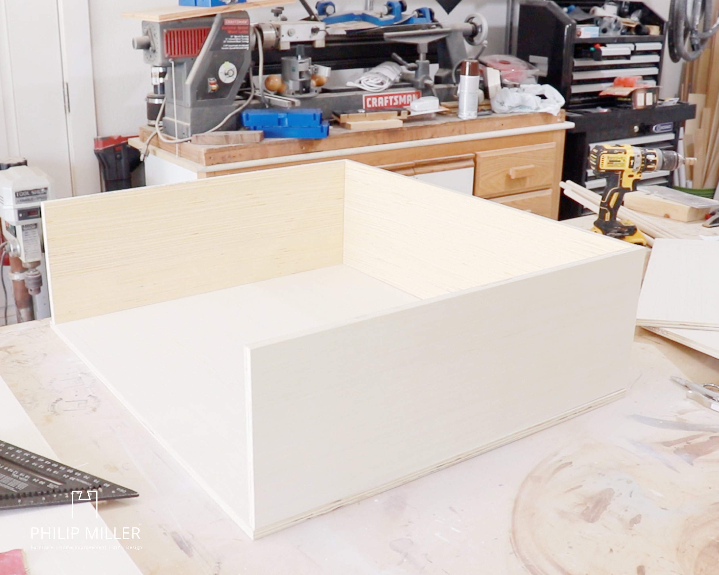 making a box for ring toss game half inch plywood on a work bench